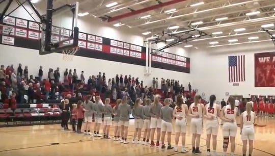 A whole gymnasium of people sang the national anthem at a North Polk High School basketball game after it wouldn't play over the sound system.