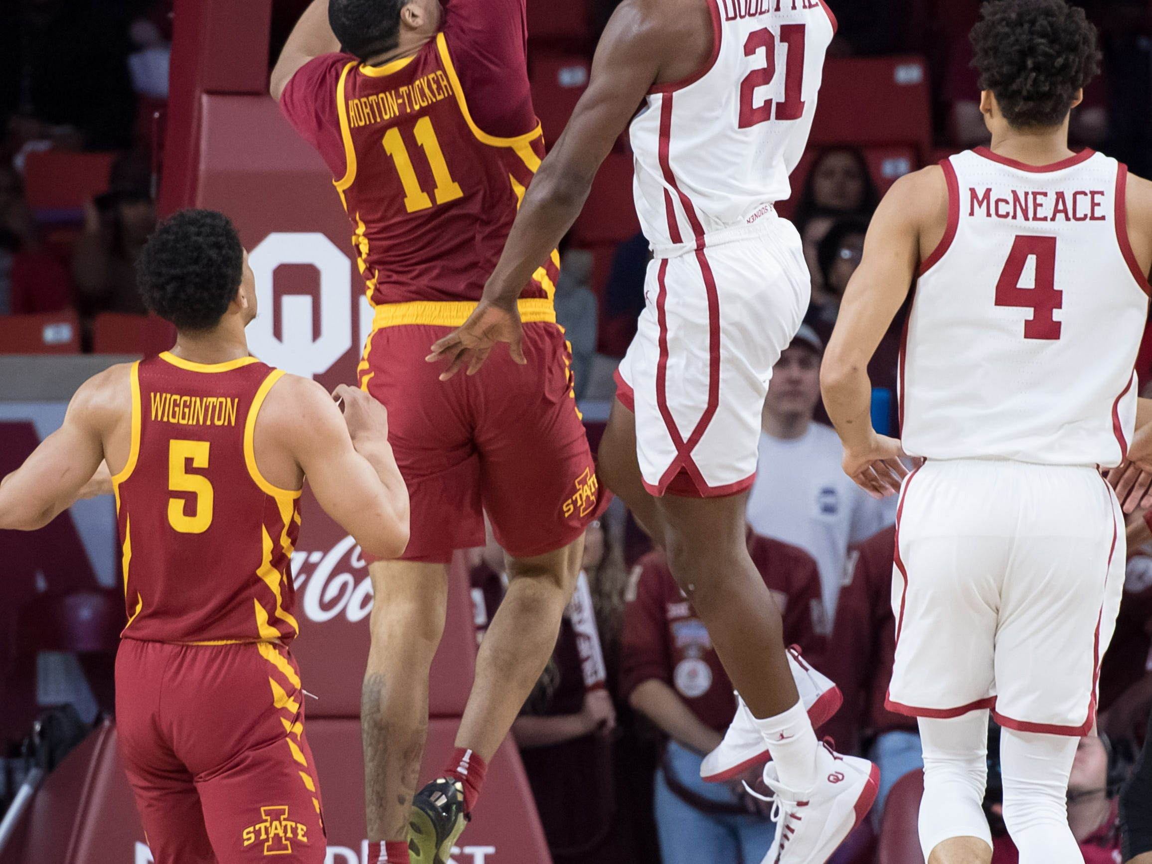 Oklahoma Sooners forward Kristian Doolittle (21) shoots the ball while defended by Iowa State Cyclones guard Talen Horton-Tucker (11) during the first half at Lloyd Noble Center.