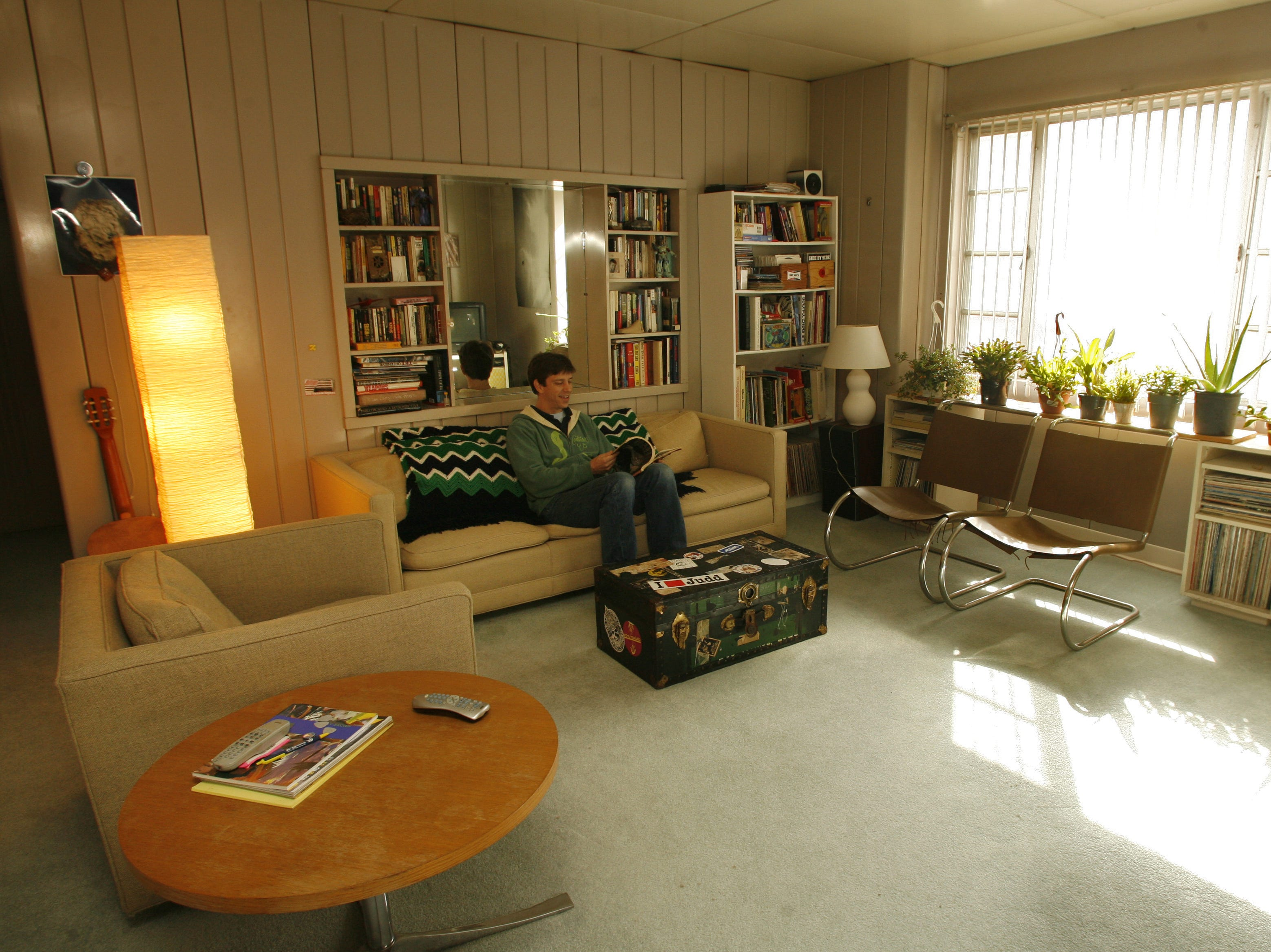 Alex Brown sits in the living room of his Lustron home in Des Moines in this 2006 file photo. Des Moines has the distinction of being one of the first cities in the nation where Lustron Corp.'s five-room all-metal houses were erected.