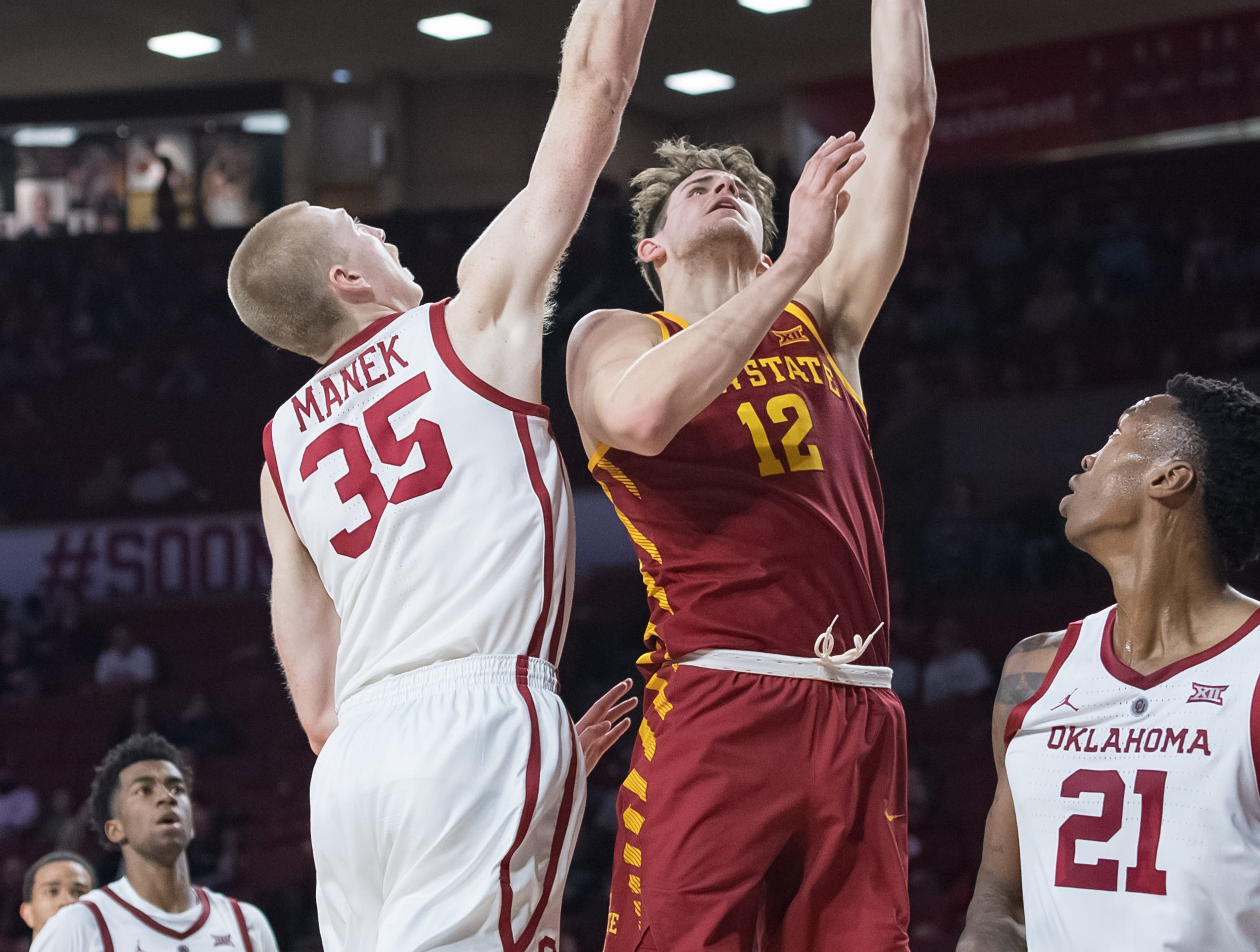 Iowa State Cyclones forward Michael Jacobson (12) shoots the ball past Oklahoma Sooners forward Brady Manek (35) during the first half at Lloyd Noble Center.