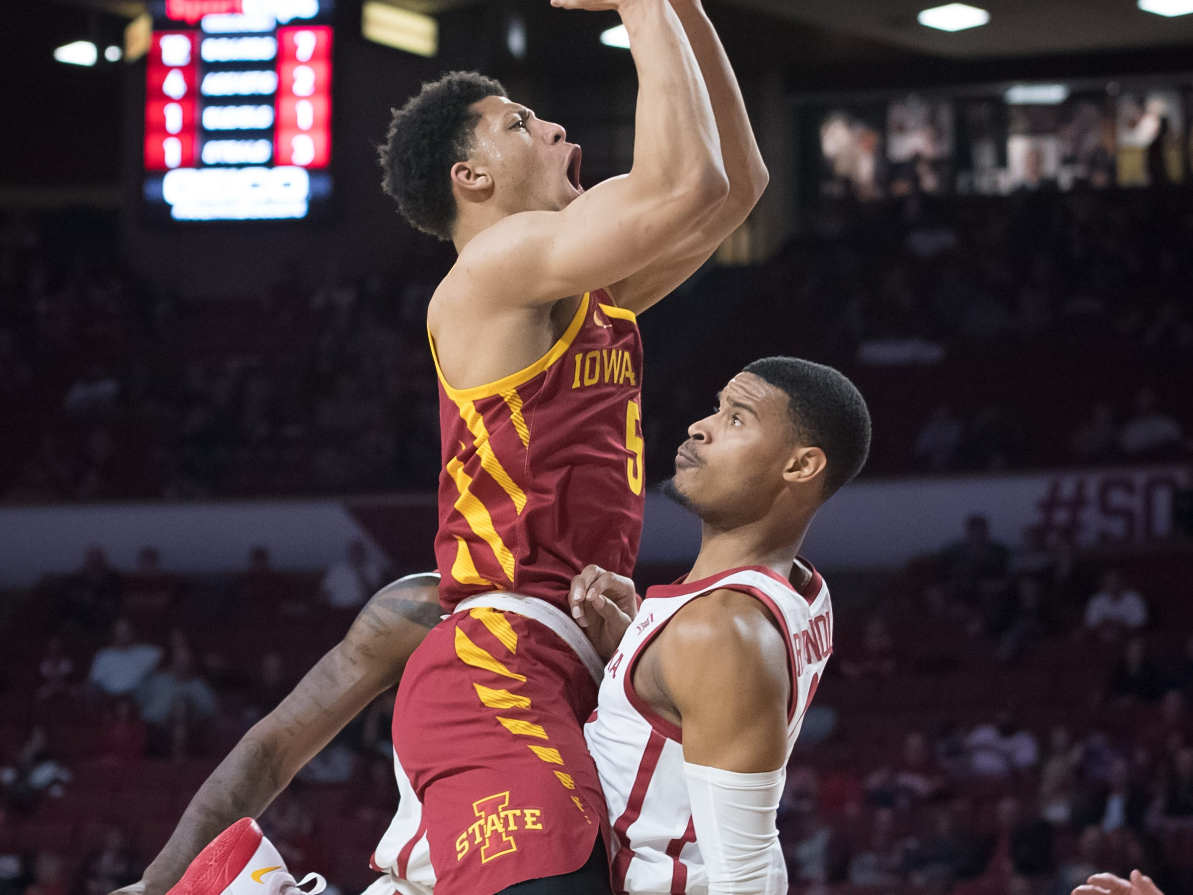 Iowa State Cyclones guard Lindell Wigginton (5) shoots the ball over Oklahoma Sooners guard Miles Reynolds (3) during the first half at Lloyd Noble Center.