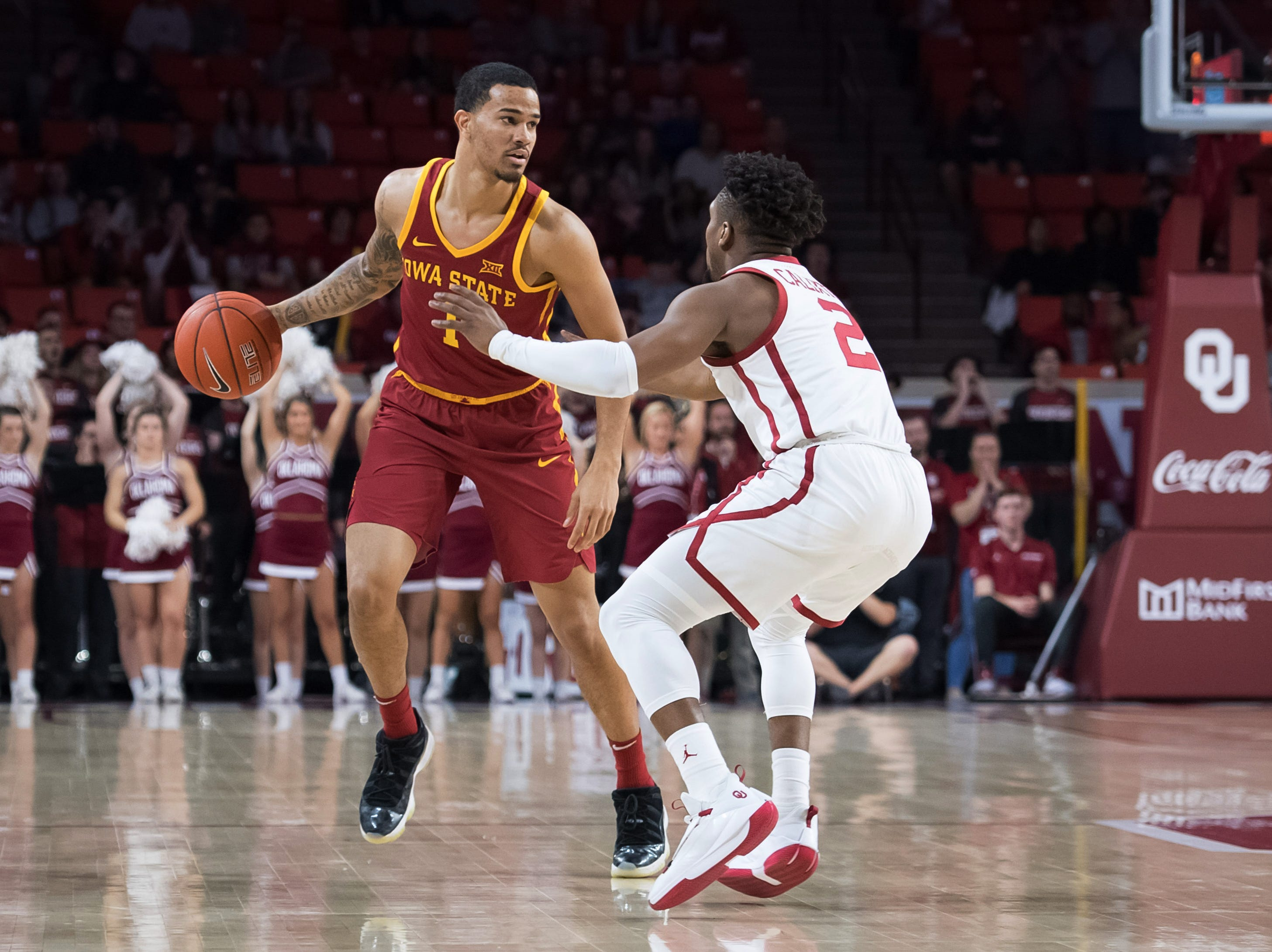 Iowa State Cyclones guard Nick Weiler-Babb (1) dribbles the ball defended by Oklahoma Sooners guard Aaron Calixte (2) during the first half at Lloyd Noble Center.
