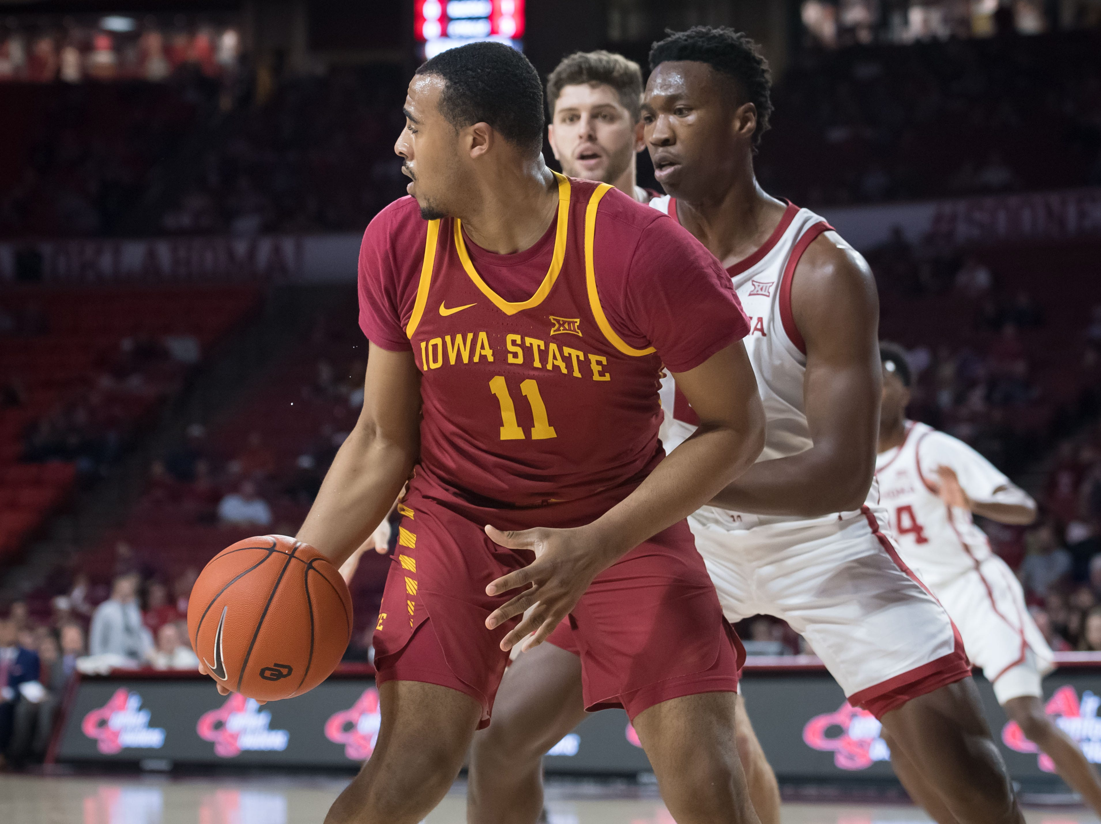 Iowa State Cyclones guard Talen Horton-Tucker (11) fights for position while defended by Oklahoma Sooners forward Kristian Doolittle (21) during the first half at Lloyd Noble Center.