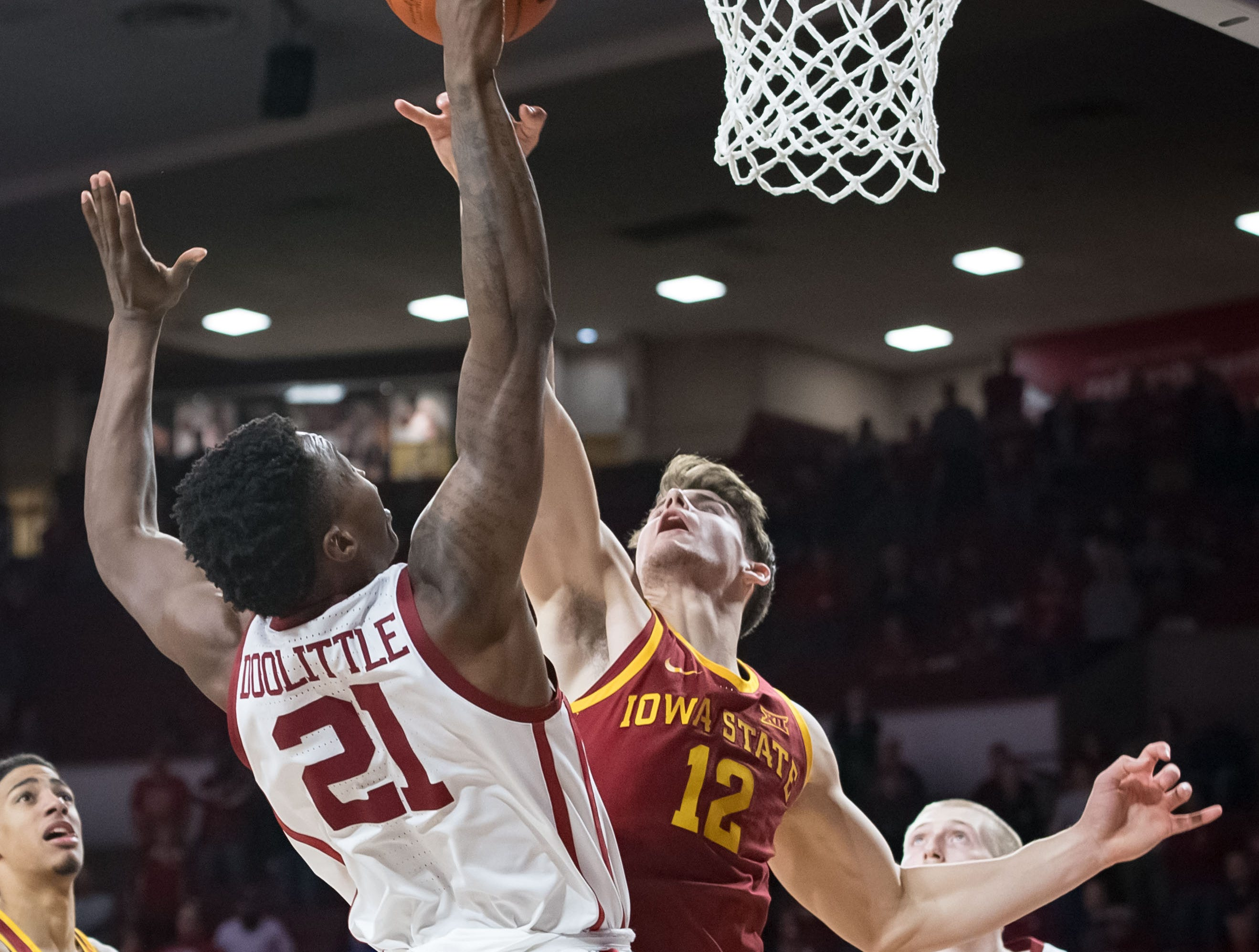 Oklahoma Sooners forward Kristian Doolittle (21) shoots the ball defended by Iowa State Cyclones forward Michael Jacobson (12) during the second half at Lloyd Noble Center.
