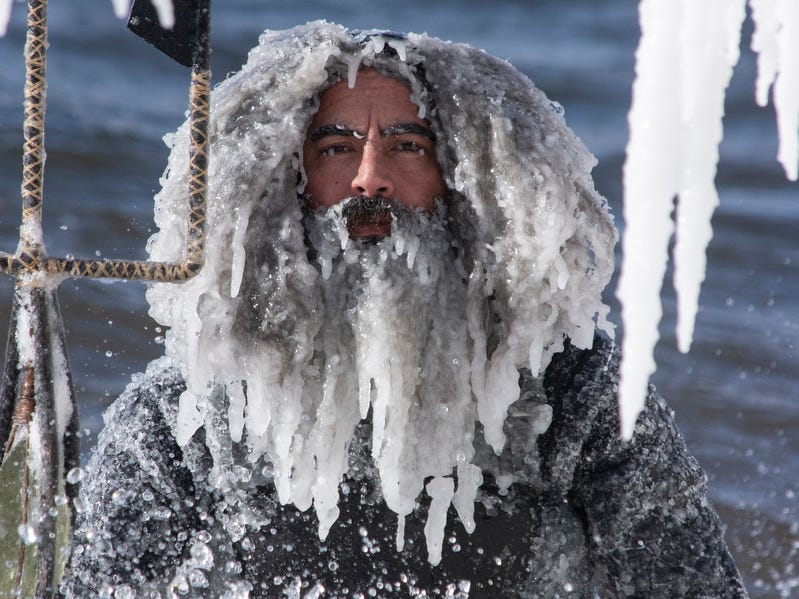Surfer Allen Fina poses for a photo in Lake Superior during the polar vortex in January, 2019, in Marquette.