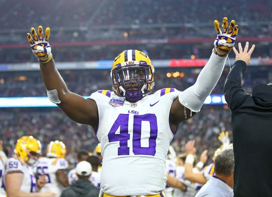 LSU linebacker Devin White on the sideline during the game against Central Florida in the 2019 Fiesta Bowl.