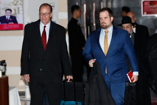 US Undersecretary for International Affairs David Malpass, left, walks with others delegates as they leave the Westin Hotel in Beijing, China, 08 January 2019.