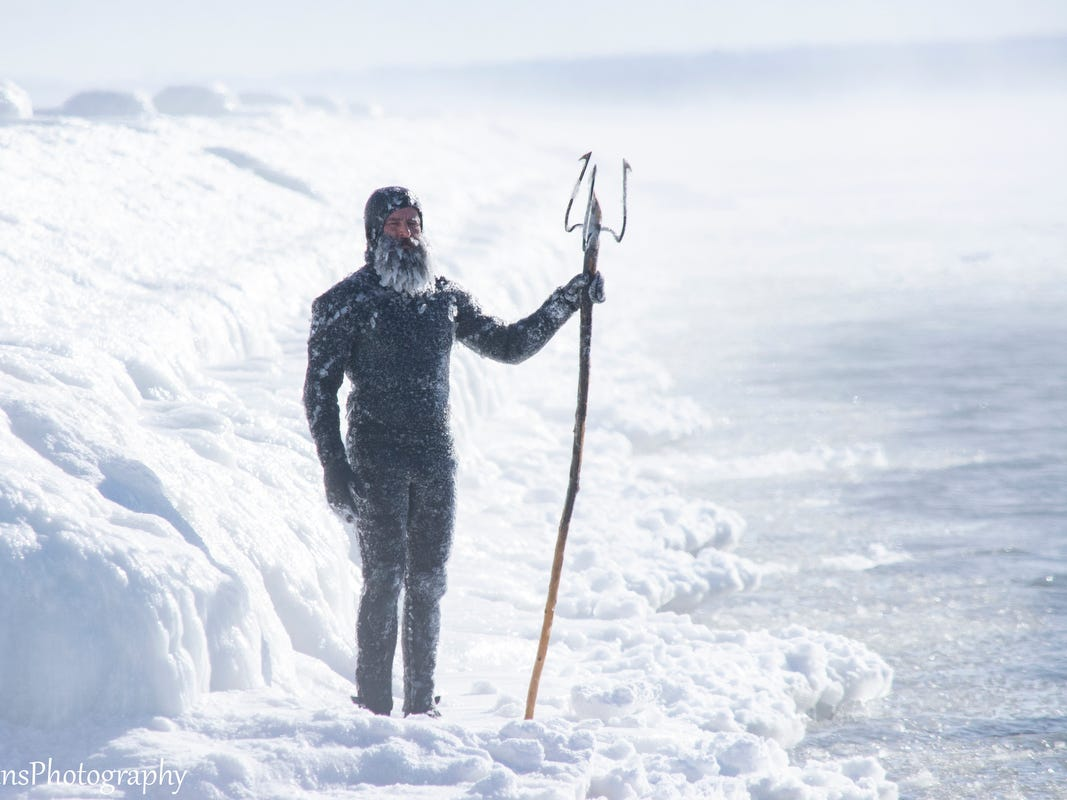 Surfer Daniel Schetter poses for photo near Lake Superior during the polar vortex in January, 2019, in Marquette.