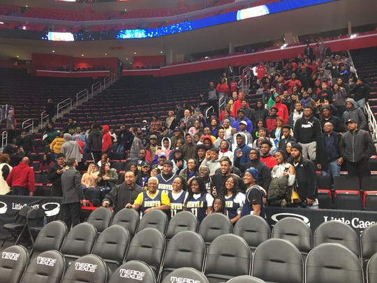 Monte Morris' friends and family after Monday's game. Morris' mom, Latonia, is front left (yellow undershirt).