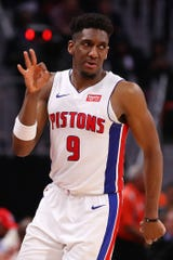 Pistons guard Langston Galloway celebrates a 3-point basket during the Pistons' 129-103 win on Monday, Feb. 4, 2019, at Little Caesars Arena.