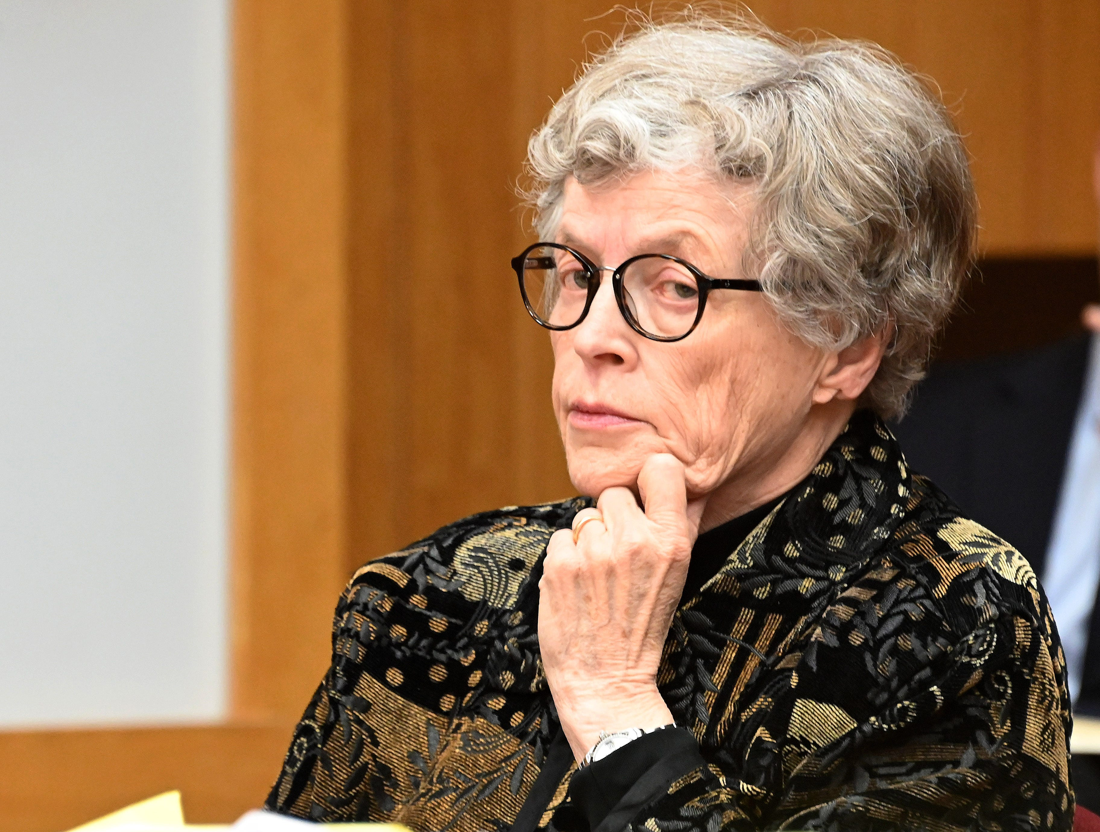 Lou Anna K. Simon looks on from her position at the defense table.