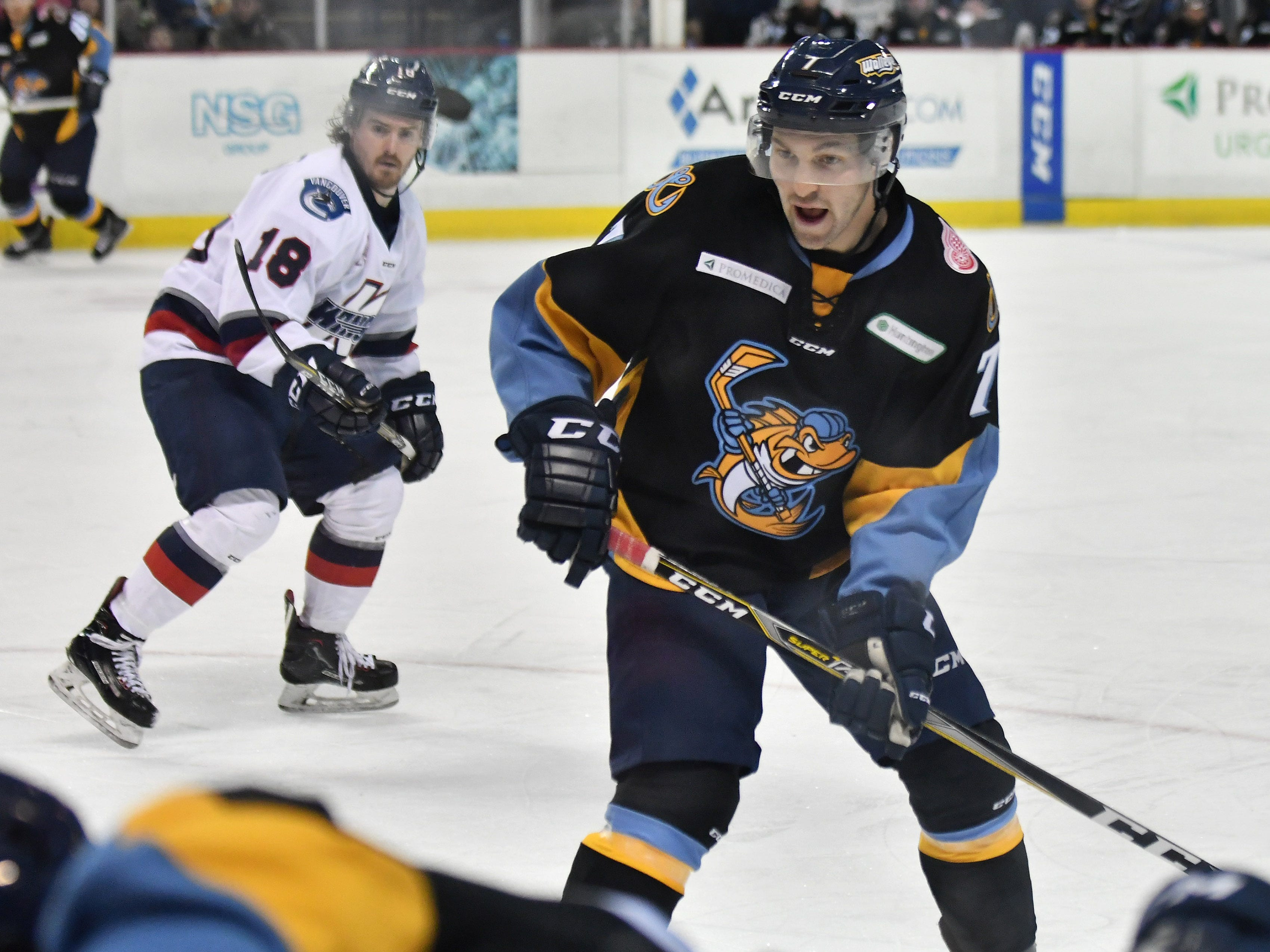 Toledo forward Tyler Spezia (7) comes over to the corner to assist a teammate in the second period.