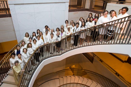 Democratic Congresswomen, dressed in 'suffragette white,' pose for a group photo Tuesday before the State of the Union address by President Donald Trump, on Capitol Hill, Tuesday.