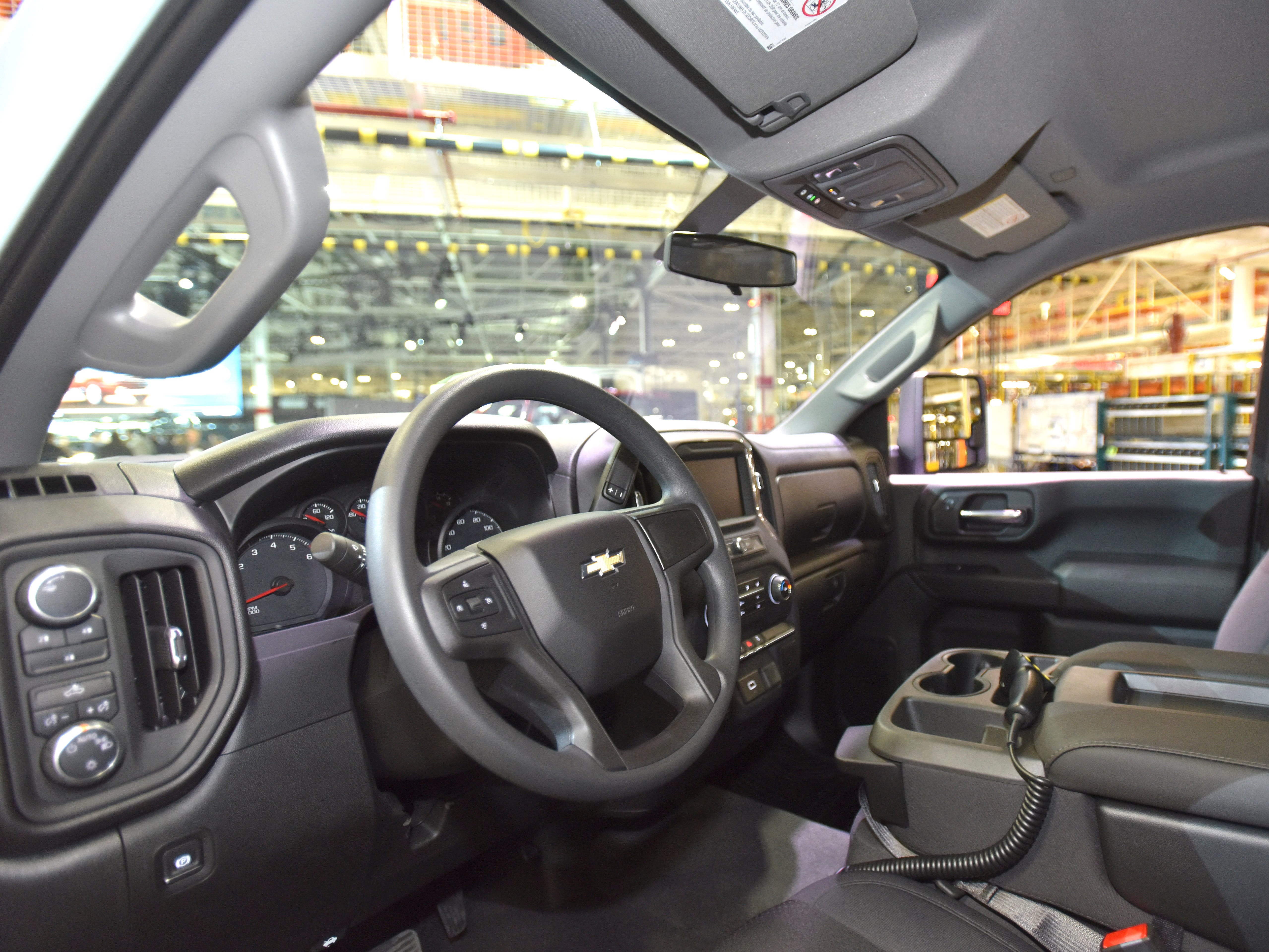 The Silverado HD's interior is seen from the driver's side. The box, which already has corner steps for easier access, gets two more steps at the front for easier, forward-box access.