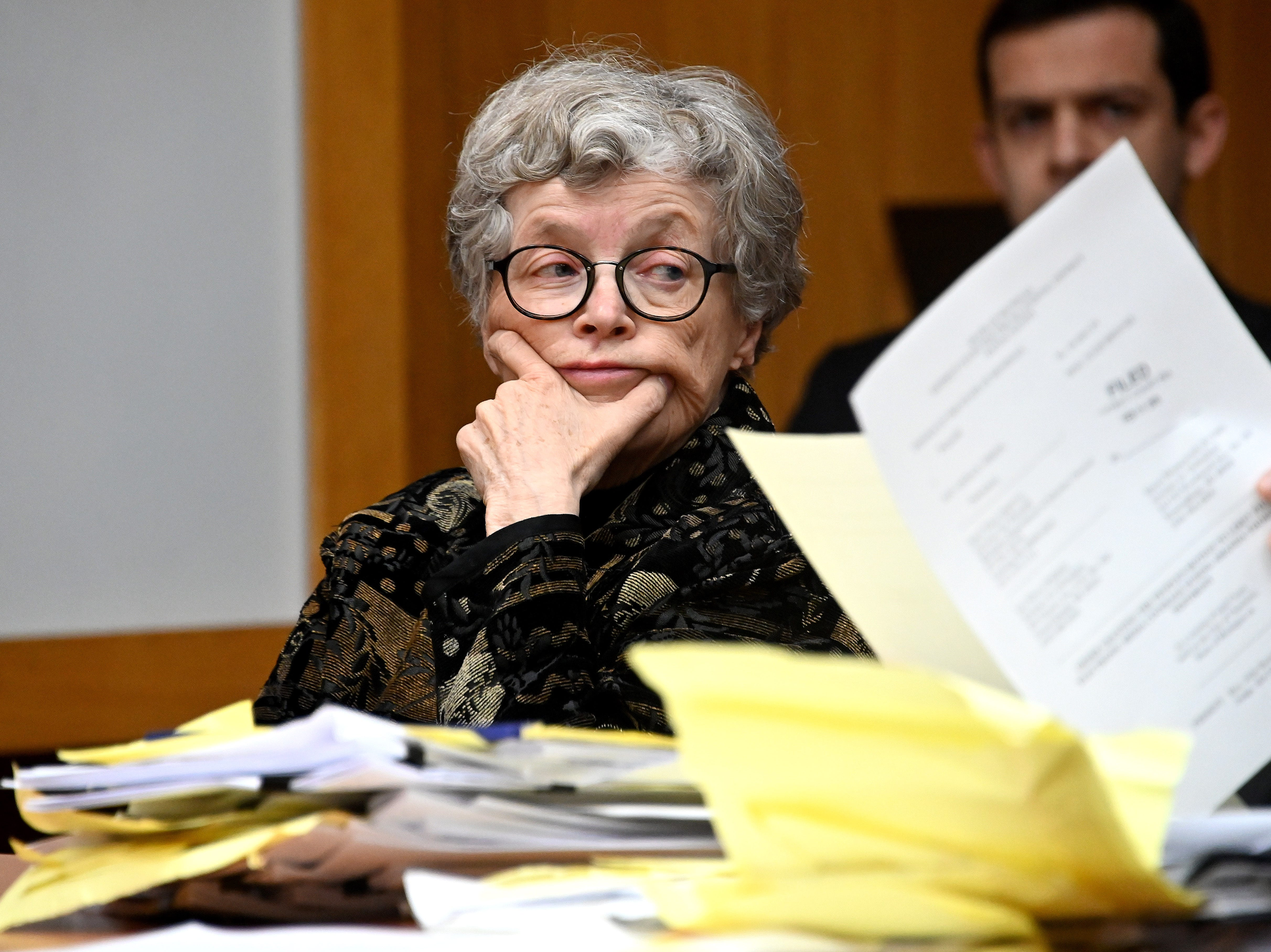 Lou Anna K. Simon looks at her attorney while sitting at the defense table at her pretrial hearing.