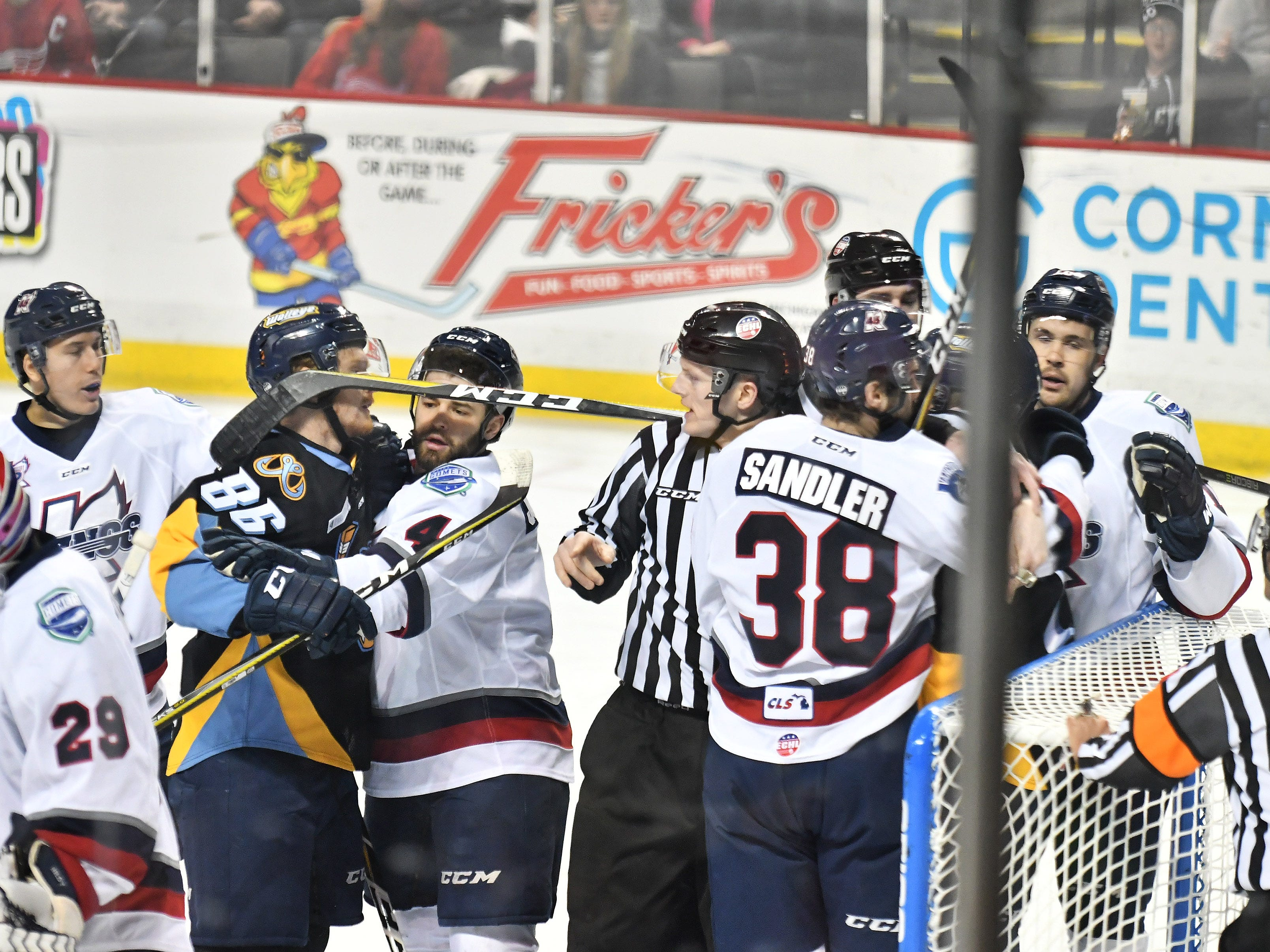 Toledo's Greg Wolfe (86) and Kalamazoo's Matt Joyaux mix it up as do other players and officials try to separate them in the first period.