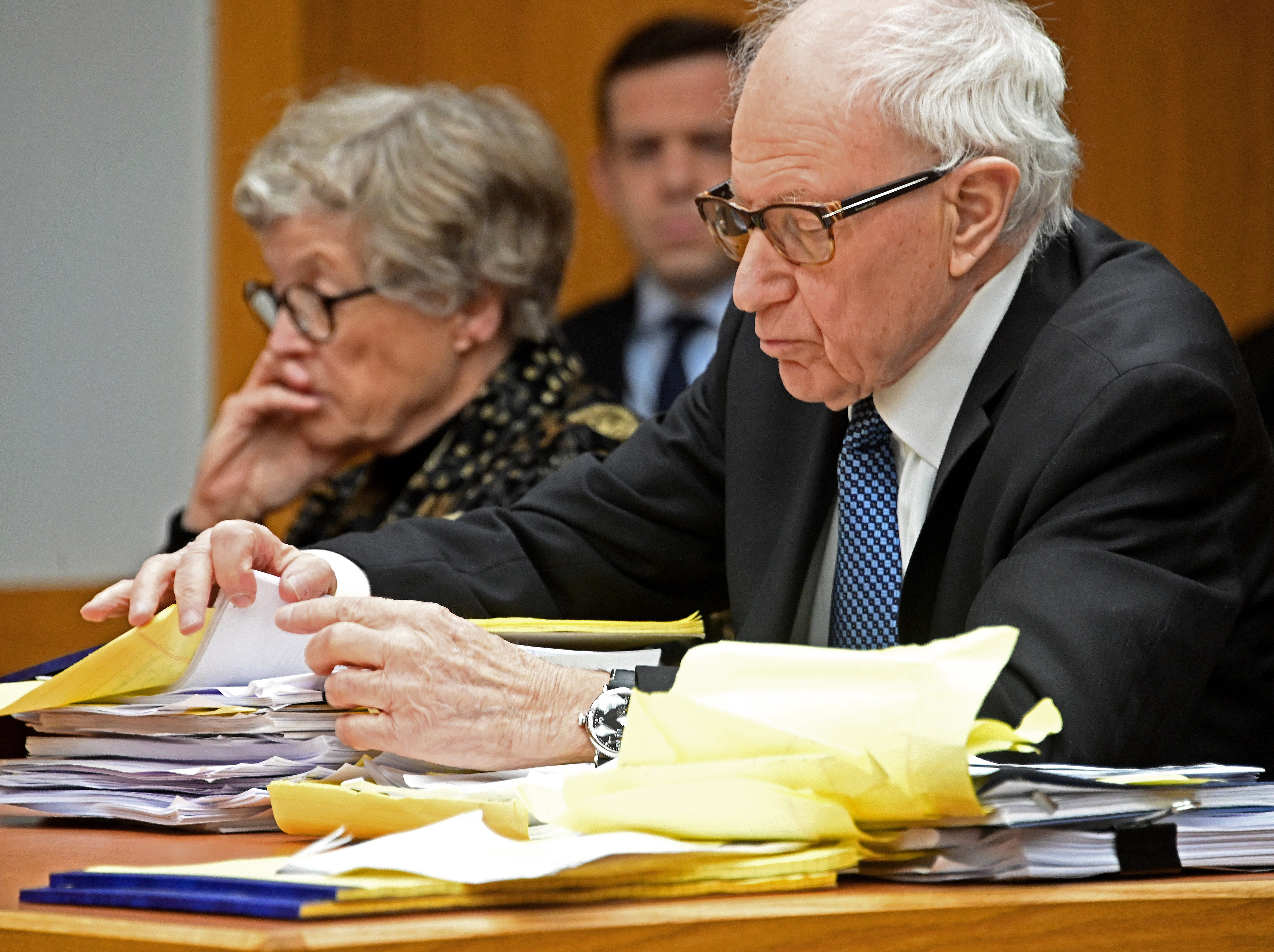 Mayer Morganroth wades through piles of notes and documents as he defends Lou Anna K. Simon in her pretrial hearing Tuesday morning.