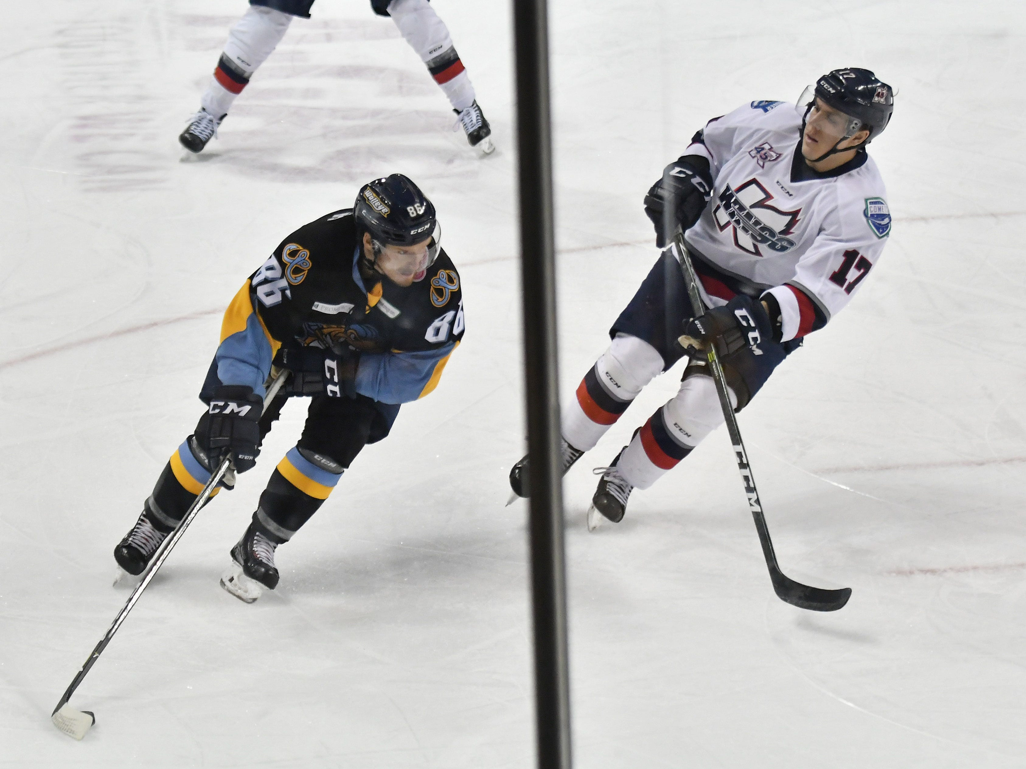 Kalamazoo defenseman Brandon Anselmini (17) comes over to cover Toledo forward Greg Wolfe (86) moving the puck in the third period.