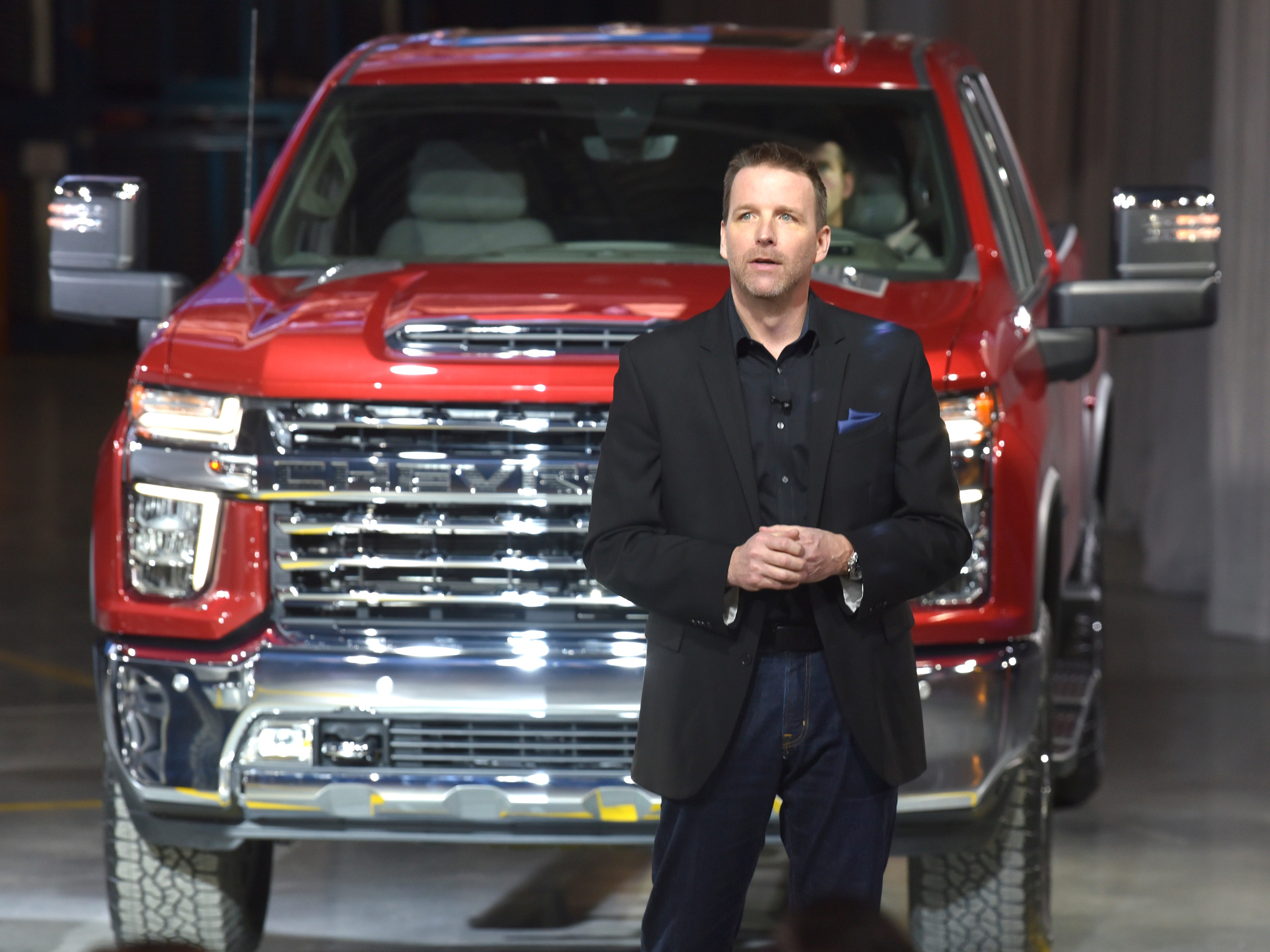 Rich Scheer, Director, Exterior Design, Chevy Trucks, talks in front of the Silverado HD.  Powered by an all-new gas-powered V-8 engine paired with the 10-speed Allison transmission that debuted on the new heavy-duty GMC Sierra last month, the new Heavy Duty breaks away from the Camaro-inspired grille design on the 1500 with a bolder fascia and bigger headlights.