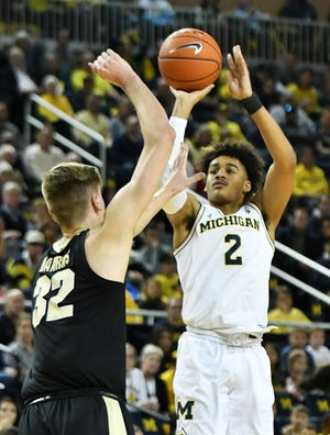 Michigan coach John Beilein is trying to get guard Jordan Poole to step closer to the 3-point line when he tries hoisting long-range shots.