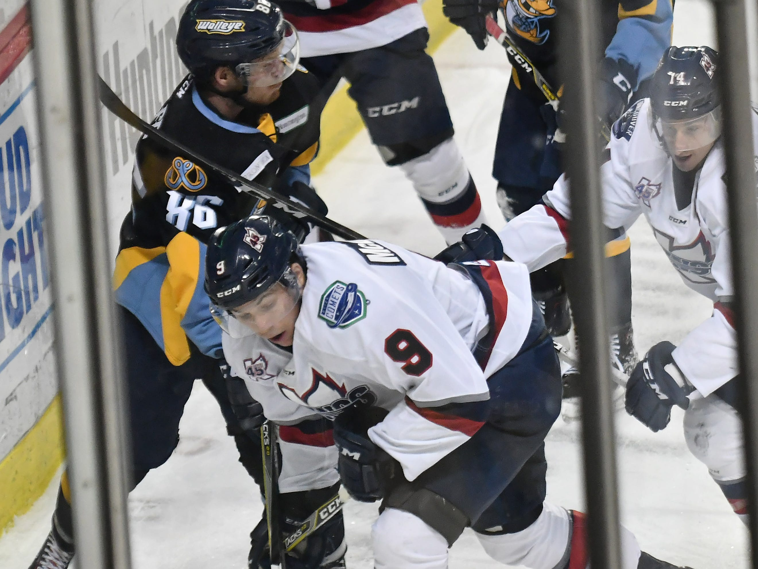 Toledo's Greg Wolfe (86) battles Kalamazoo's Chad McDonald for the puck in the second period.