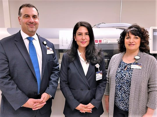 Guthrie Vice President of Lab Services George Deratany, left, joins Chief Medical Director Dr. Hani Hojjati, center, and Clinical Laboratory Director Nicole Osman.