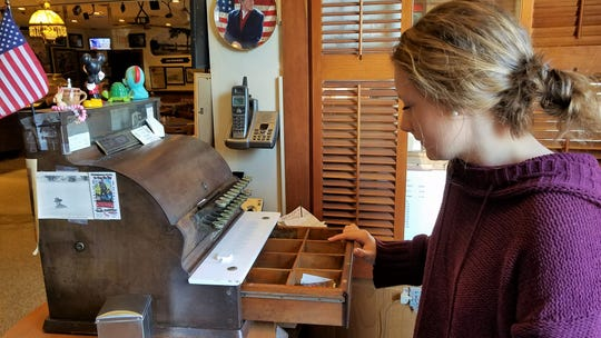 Even the cash register is a piece of memorabilia at the Windy Hollow Restaurant.