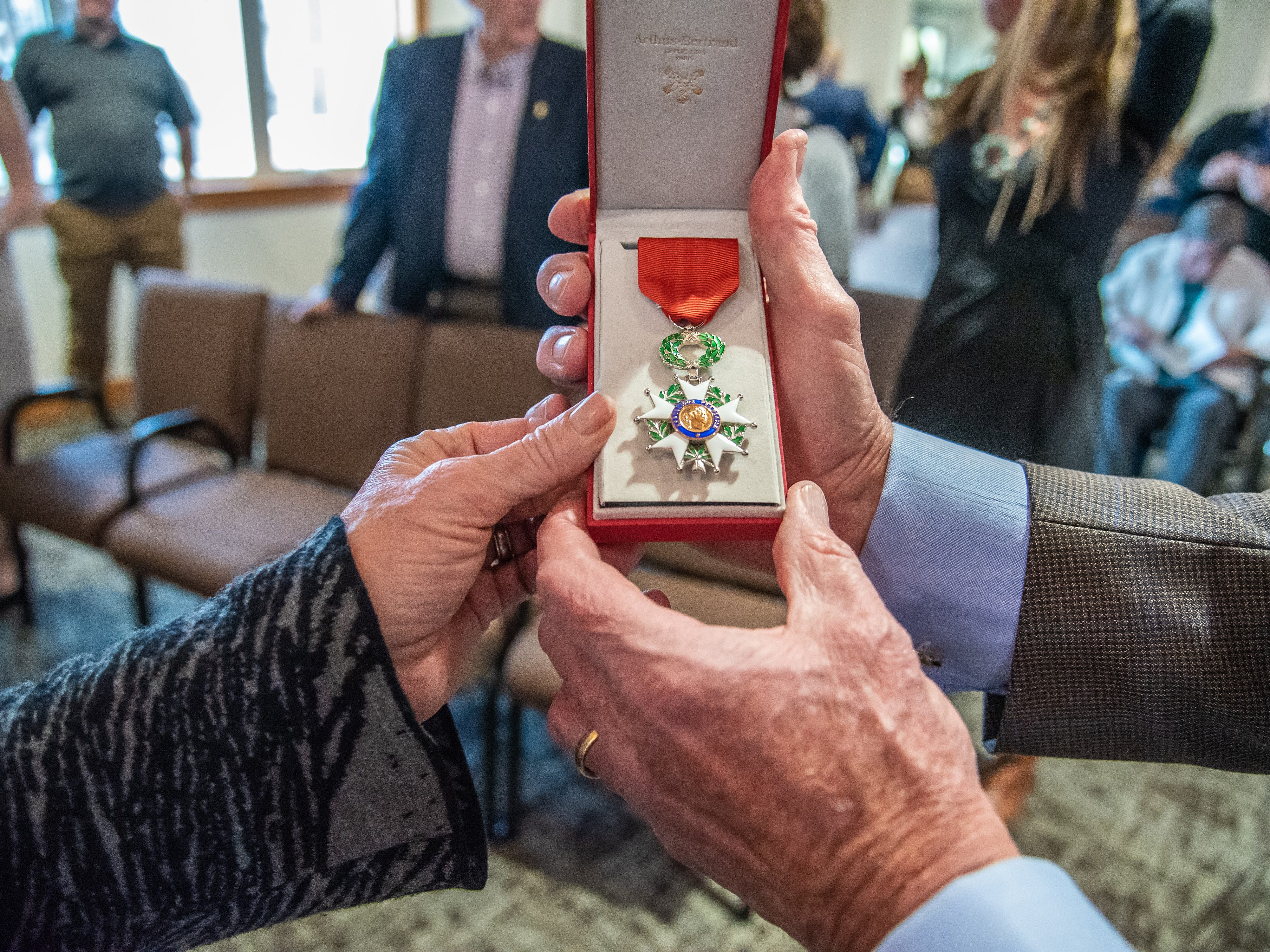 Ginger and Jack Graham display the French Legion of Honor award, given to Graham in honor of his father, a World War II veteran, at the conclusion of a ceremony on Monday, February 4, 2019,  at the Good Samaritan Water Valley Resort in Windsor.