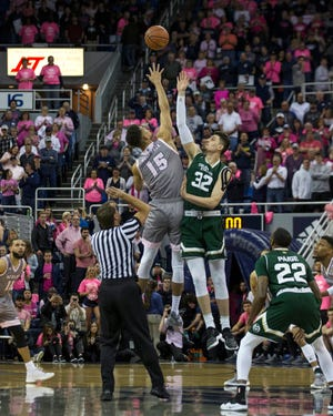 Nevada forward Trey Porter (15) and Colorado State center Nico Carvacho (32) compete for a jump ball to start an NCAA college basketball game in Reno, Nev., on Jan. 23, 2019.