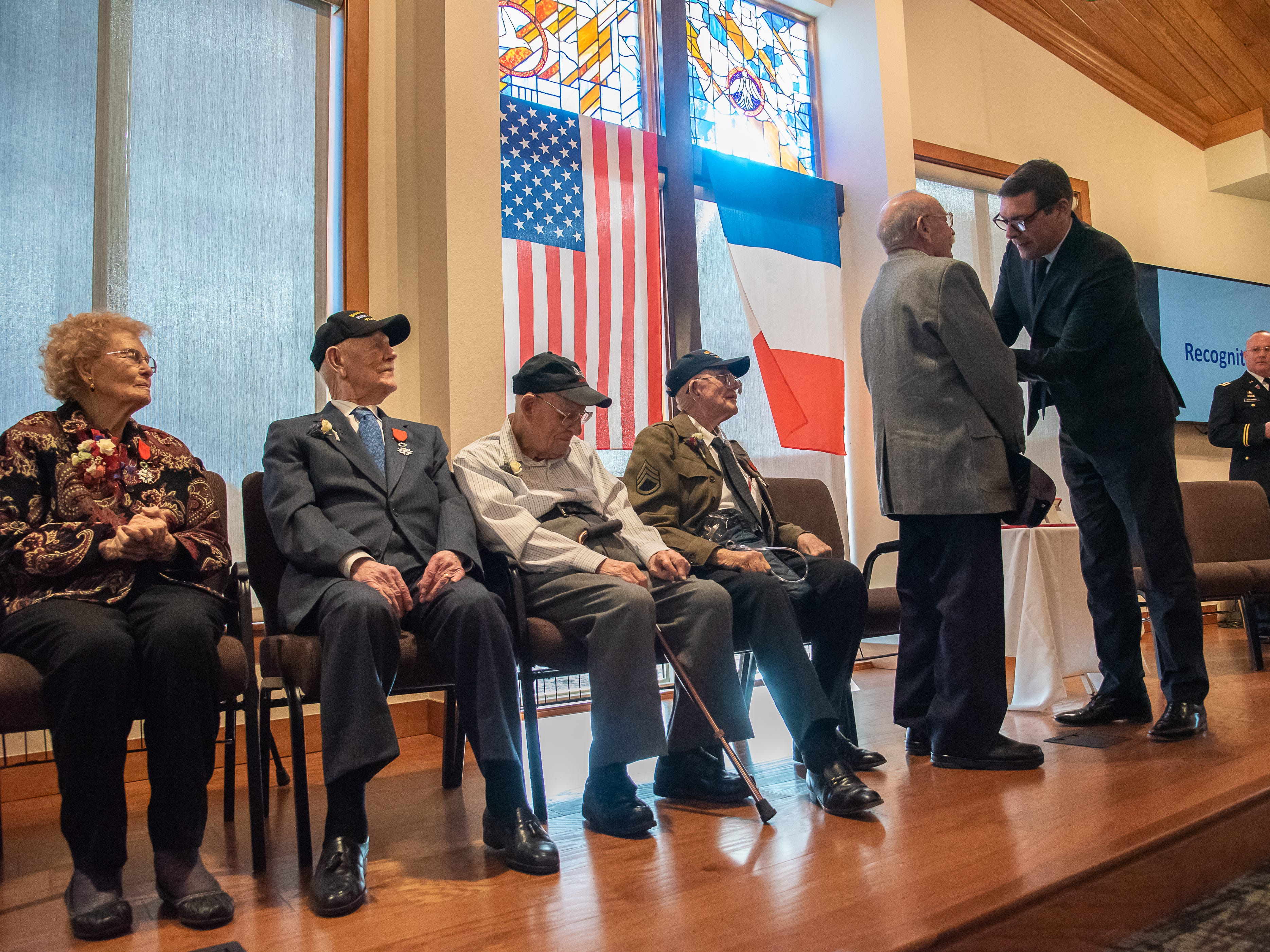 Fort Collins resident and World War II veteran SSG Harry Maroncelli stands to receive the French Legion of Honor Medal from Christophe Lemoine, Consulate of France, on Monday, February 4, 2019, during a ceremony at the Good Samaritan Water Valley Resort in Windsor.