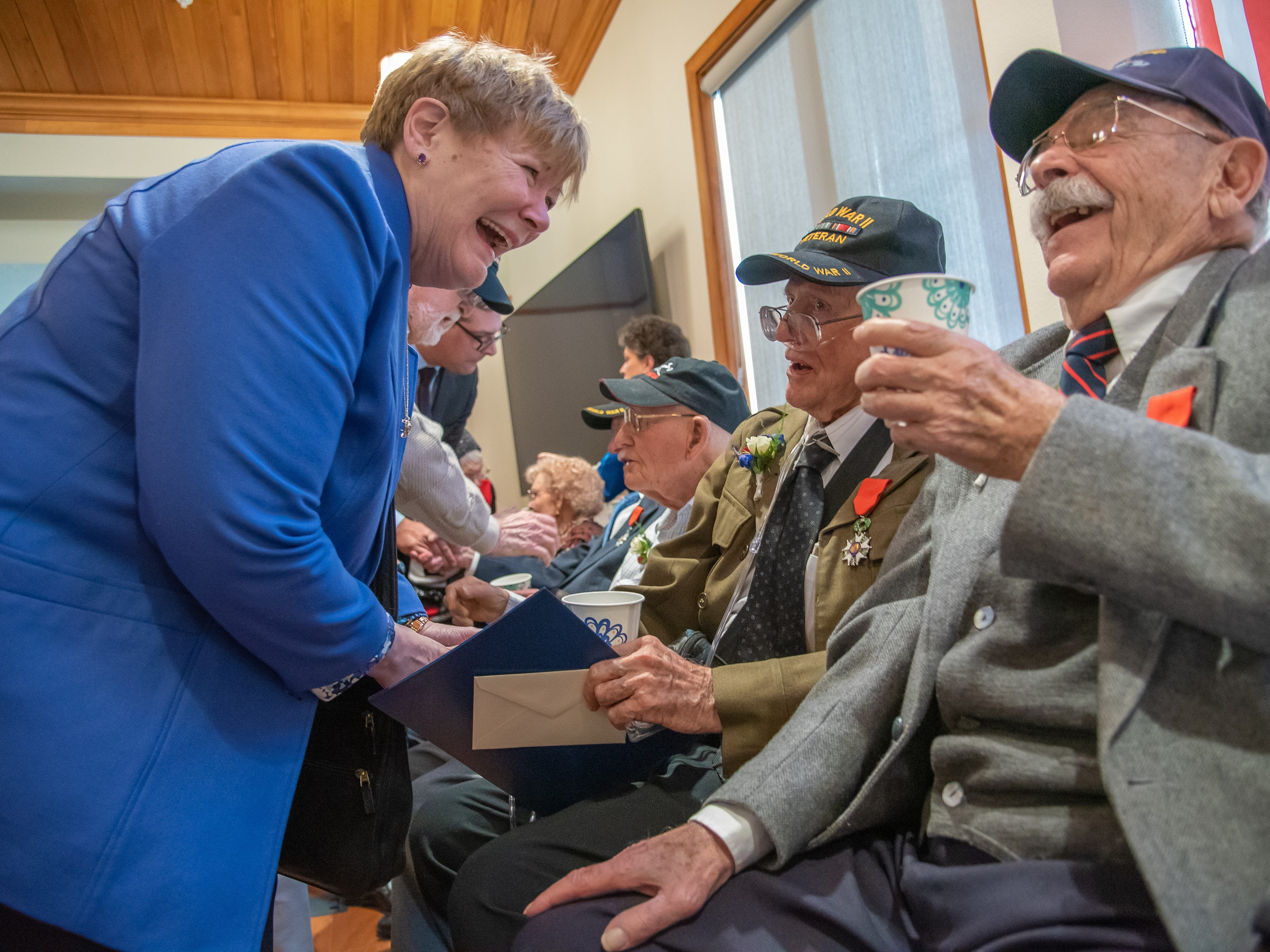 SSG Harry Maroncelli, World War II veteran and Fort Collins resident, shares a laugh with an audience member after receiving the French Legion of Honor on Monday, February 4, 2019, during a ceremony at the Good Samaritan Water Valley Resort in Windsor.