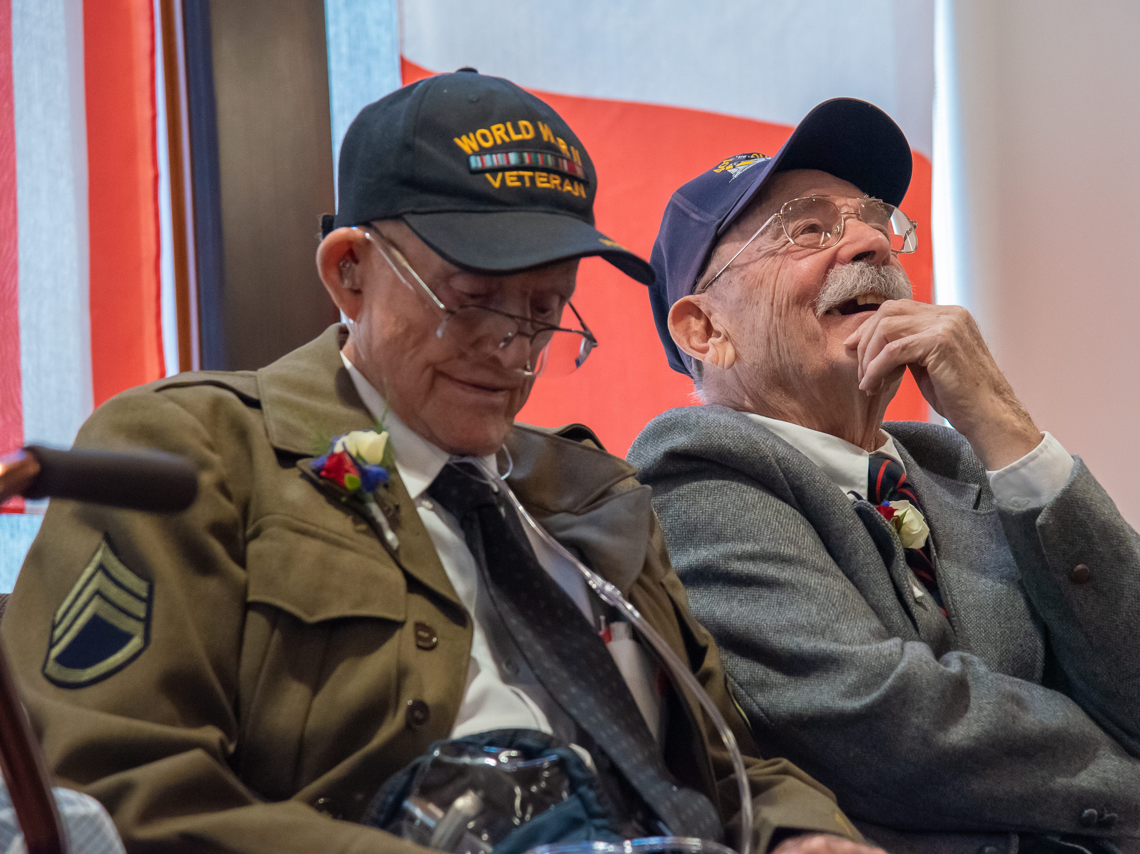 Fort Collins resident and World War II veteran SSG Harry Maroncelli chuckles as he listens to Ltc. Frank Huffman introduce him to the crowd at a the French Legion of Honor Medal ceremony at the Good Samaritan Water Valley Resort in Windsor on Monday, February 4, 2019.