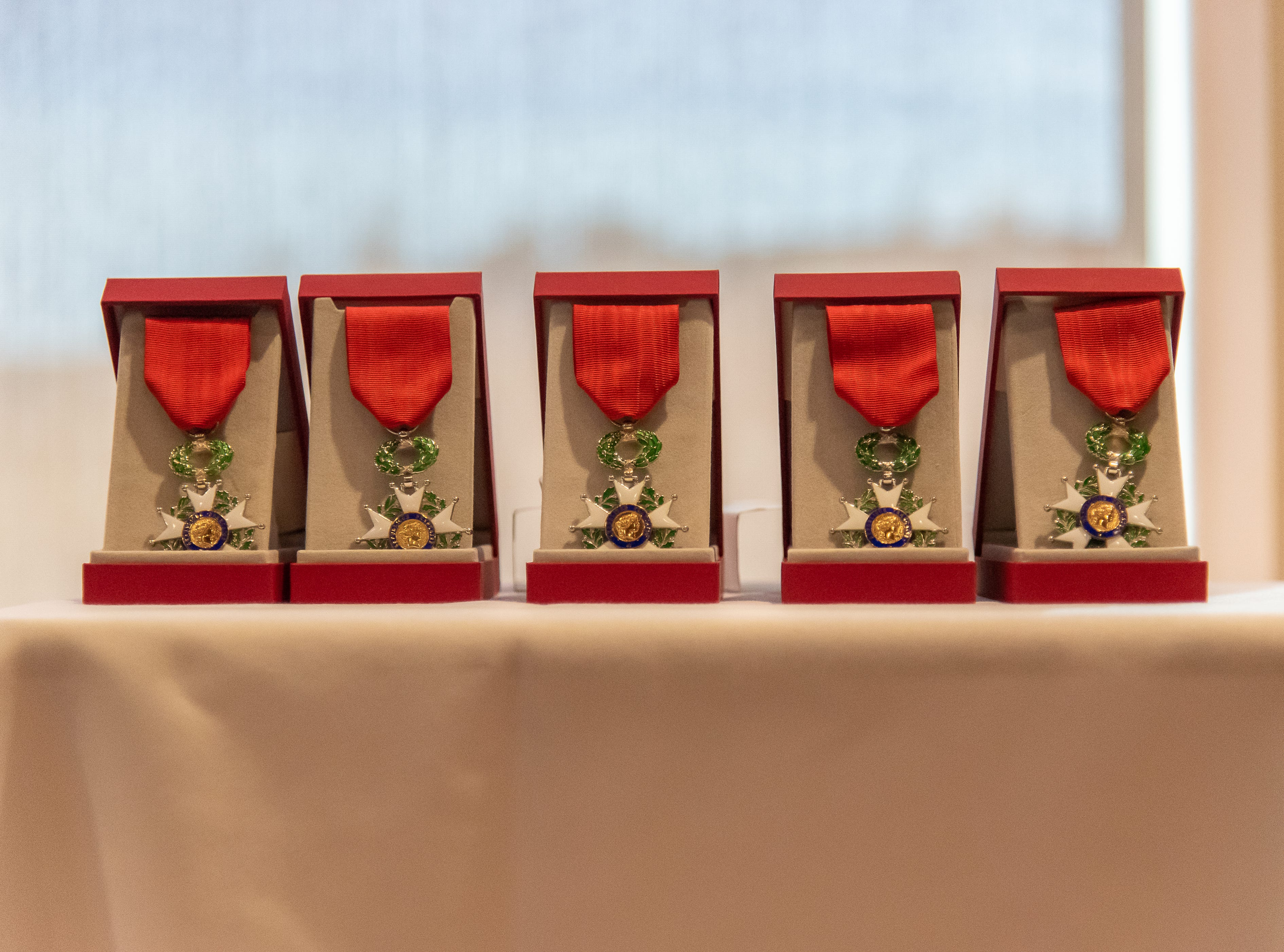 French Legion of Honor Medals are displayed on a table in preparation for a presentation ceremony on Monday, February 4, 2019, at the Good Samaritan Water Valley Resort in Windsor. Five local World War II veterans received the medals.