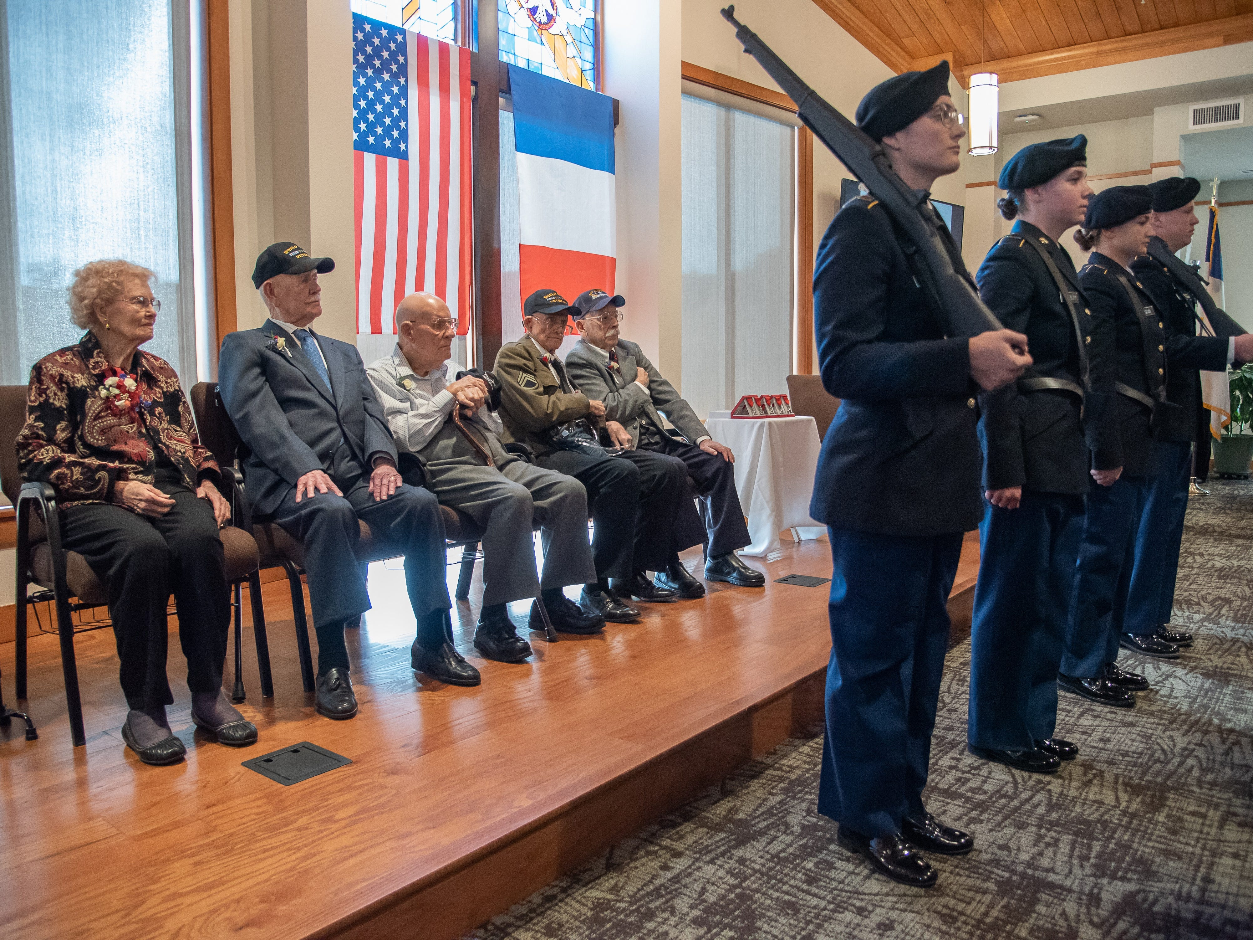 Local World War II veterans line the stage at the beginning of a French Legion of Honor Ceremony at the Good Samaritan Water Valley Resort in Windsor on Monday, February 4, 2019.