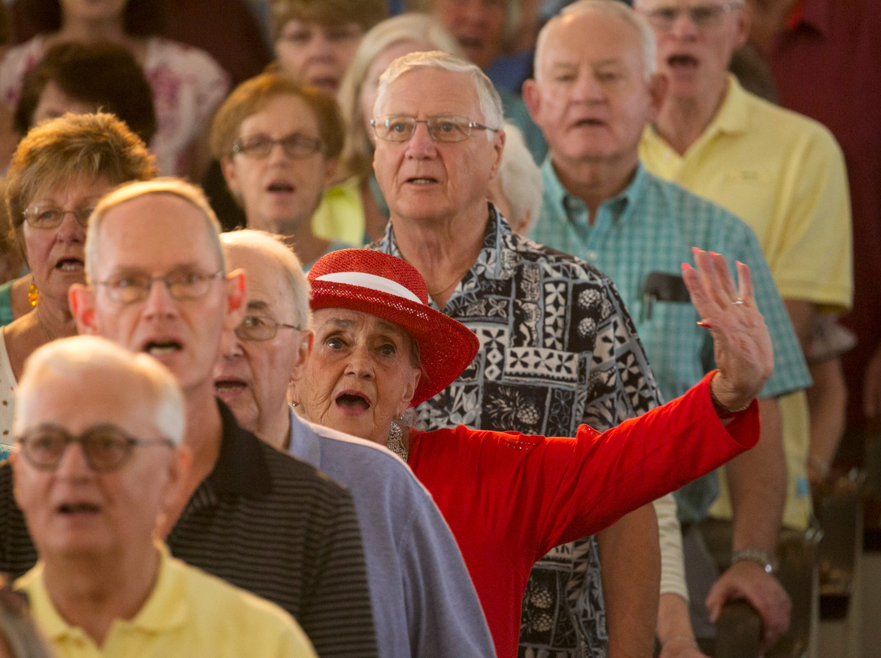 Marci Stoner sings God Bless America with the congregation during the 30th annual Mrs. Edison's Hymn Sing on Tuesday, February 5, 2019, at First Presbyterian Church in Fort Myers.