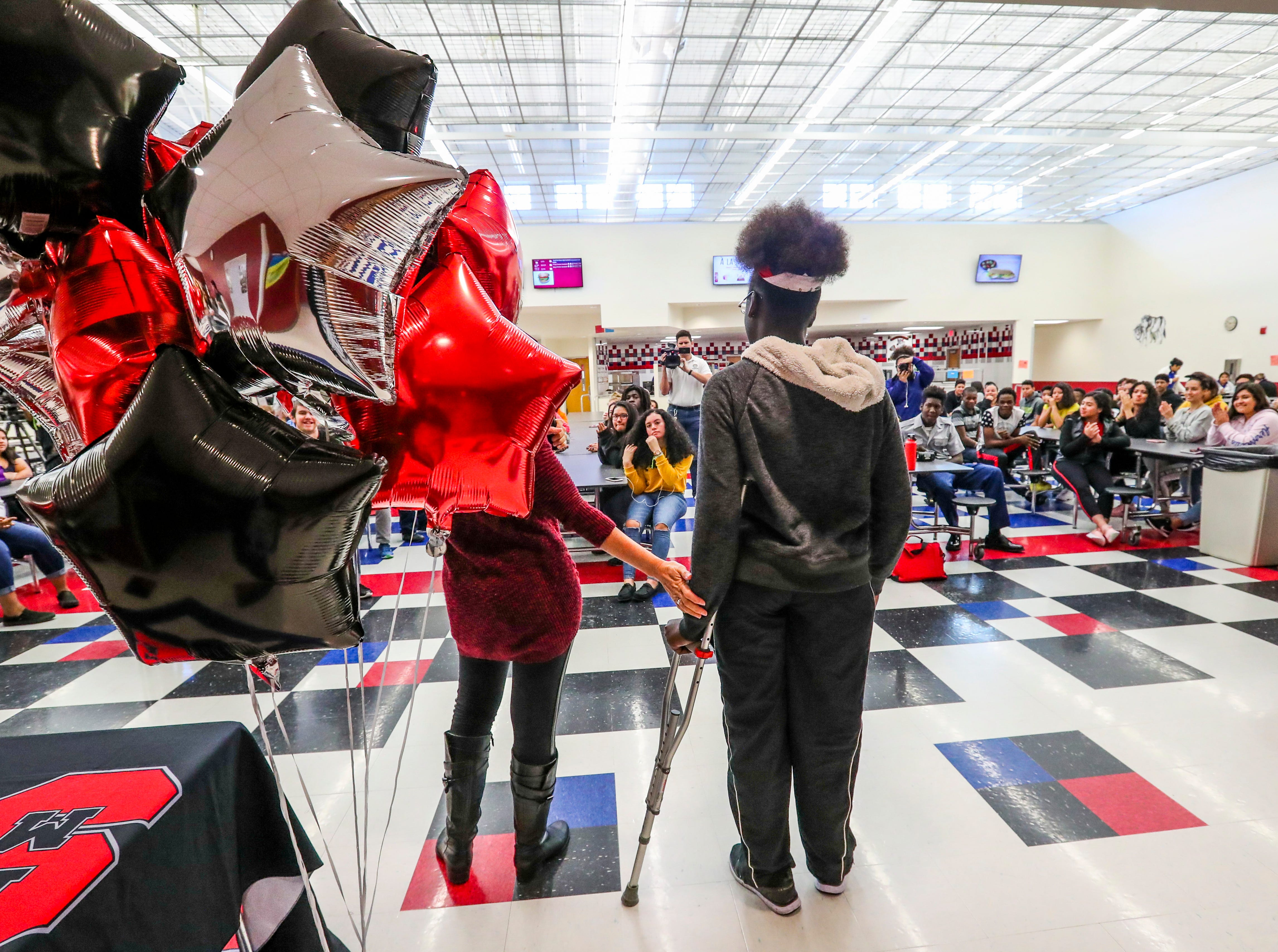 Alia Sainval walks into the cafeteria using her new prothetic leg. South Fort Myers High School student Alia Sainval was born with only one leg. She was using crutches to walk until they broke and she had to use a wheelchair. Here classmates felt this wasn't fair and raised money to get her a prosthetic leg. Alia was just given a prosthetic leg and is walking for the very first time in her life. The National Honor Society raised the money for the leg. They had a celebration in the lunchroom to thank everyone involved.