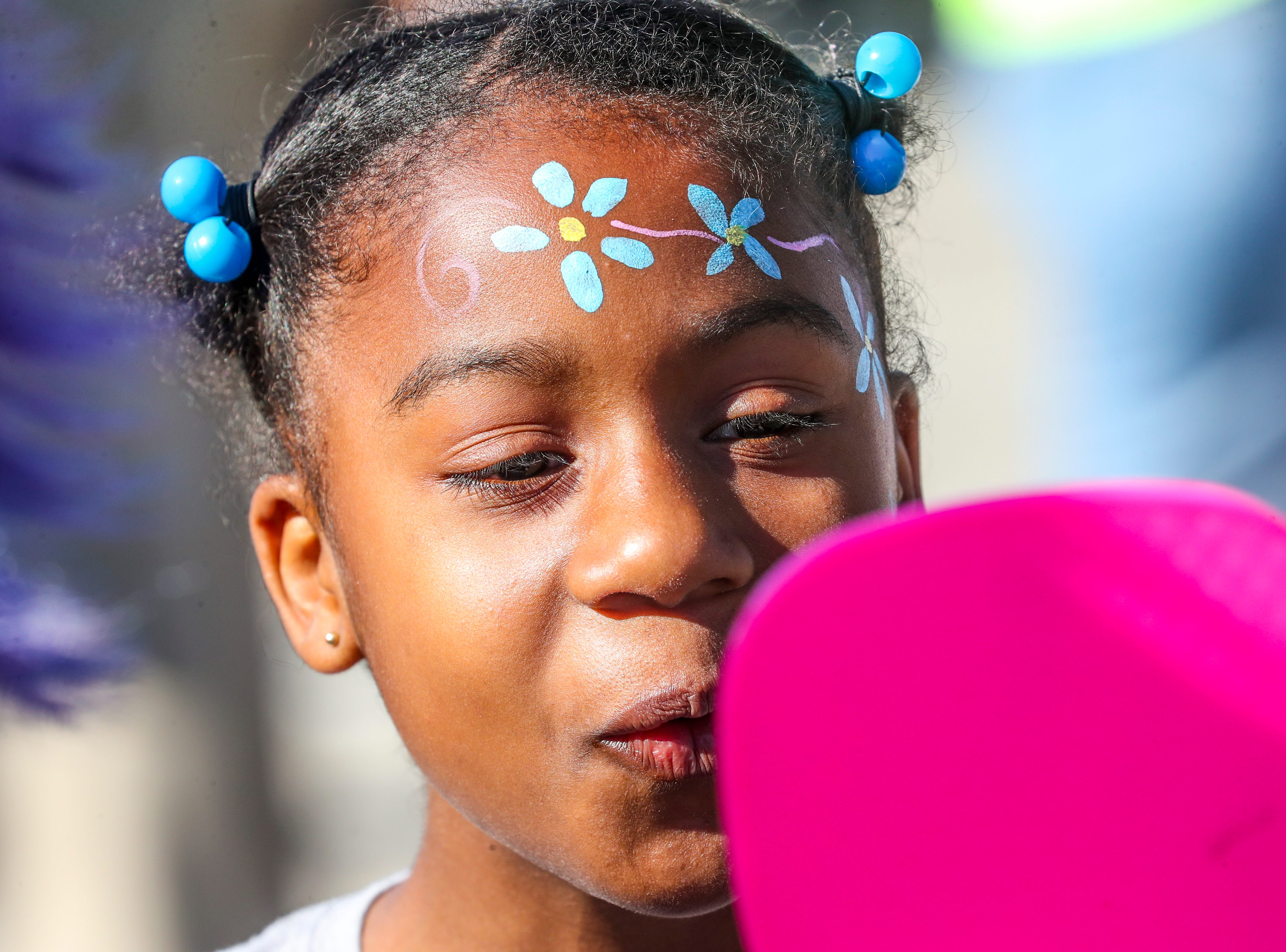 Marissa Darby 9 of Cape Coral reacts to her face paint. The 11th annual WINK Feeds Family hunger walk that supports the Harry Chapin Food Bank of Southwest Florida went off Saturday, January 19, 2019. The walk was held at Miromar Outlets in Estero, FL, and they did a 2 mile walk around the mall.