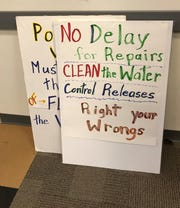 Signs brought to the Army Corps' Tuesday listening session on its Lake O management