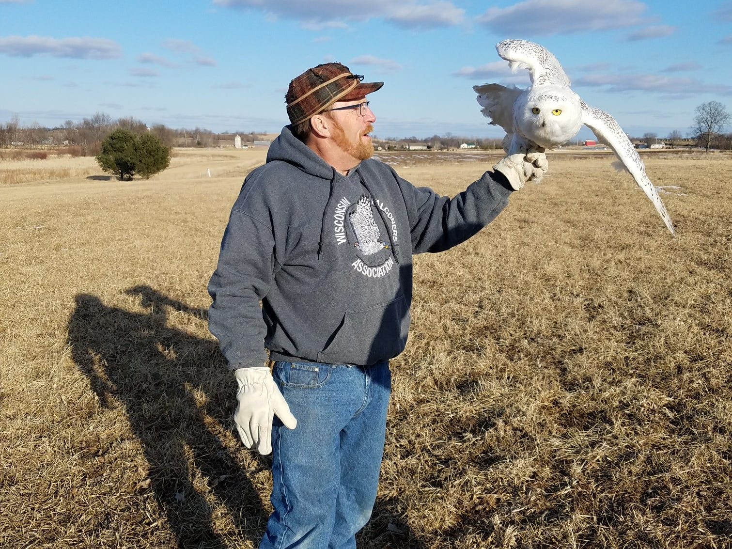 Frank Ujazdowski of the Fox Cities with a snowy owl he captured March 2018 at Wittman Regional Airport in Oshkosh. Ujazdowski is a volunteer falconer and a cofounder of Project SOAR, which works to rescue snowy owls from becoming hazards at airports.