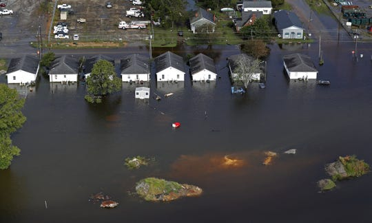 Floodwaters from Hurricane Florence surround homes Monday in Dillon in 2018. The small town in the Pee Dee region has held onto a fairly stable population over the years.