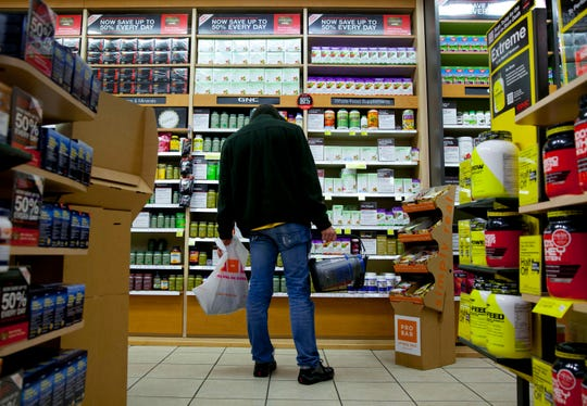 A customer shops at a GNC store in New York on Feb. 14, 2013.
