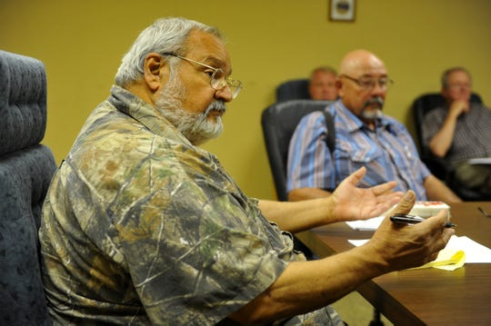 The late George Paul, former chairman of the Cascade County Republican Central Committee, leads a committee meeting in the basement of the Wheat Building in 2015. JC Kantorowicz is in the background.