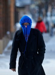 Michael Tetreault braves the subzero temperatures while walking in downtown Great Falls, Tuesday.