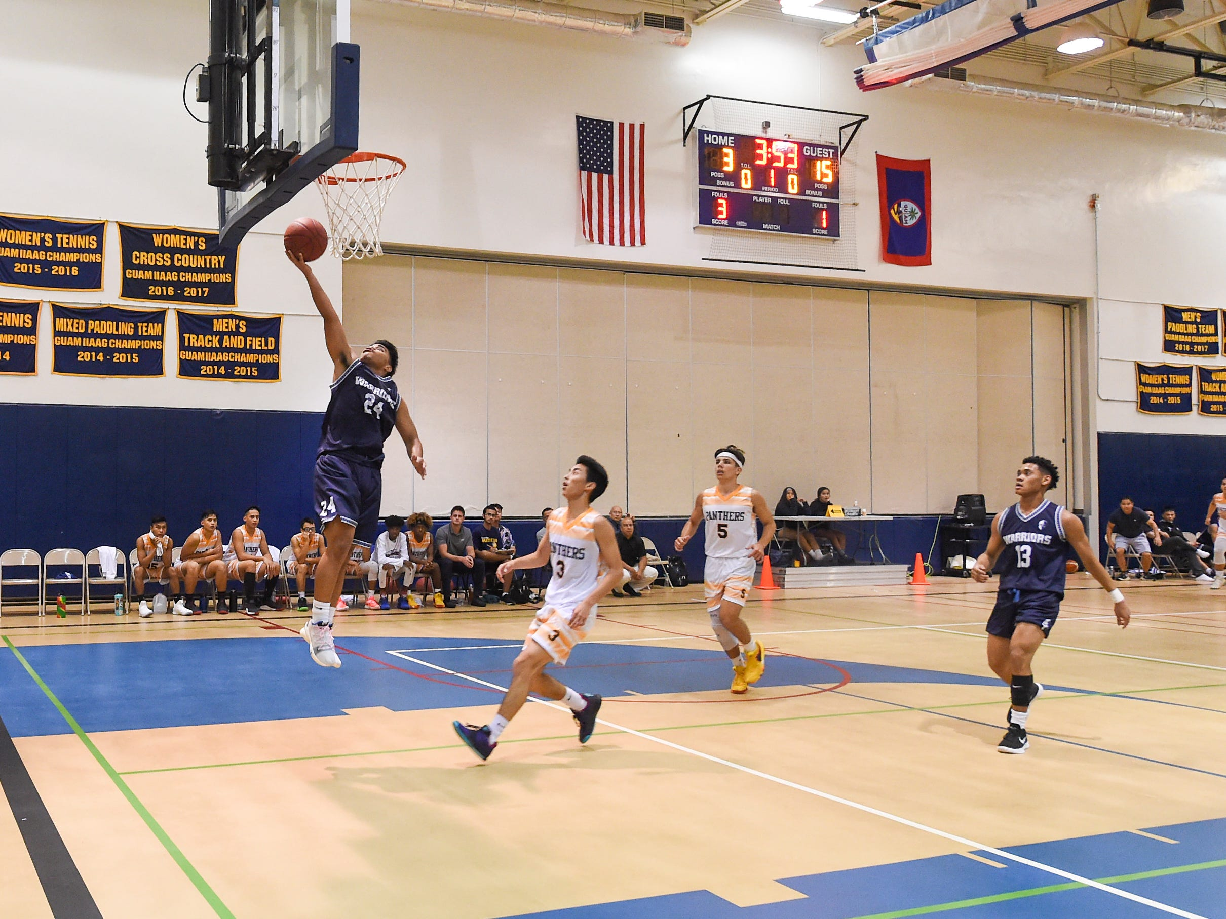 St. Paul's Thelo Orichiro (24) scores on a fast break against the Guam High Panthers during their IIAAG Boys' Basketball game at the Guam High School Gym, Feb. 5, 2019.
