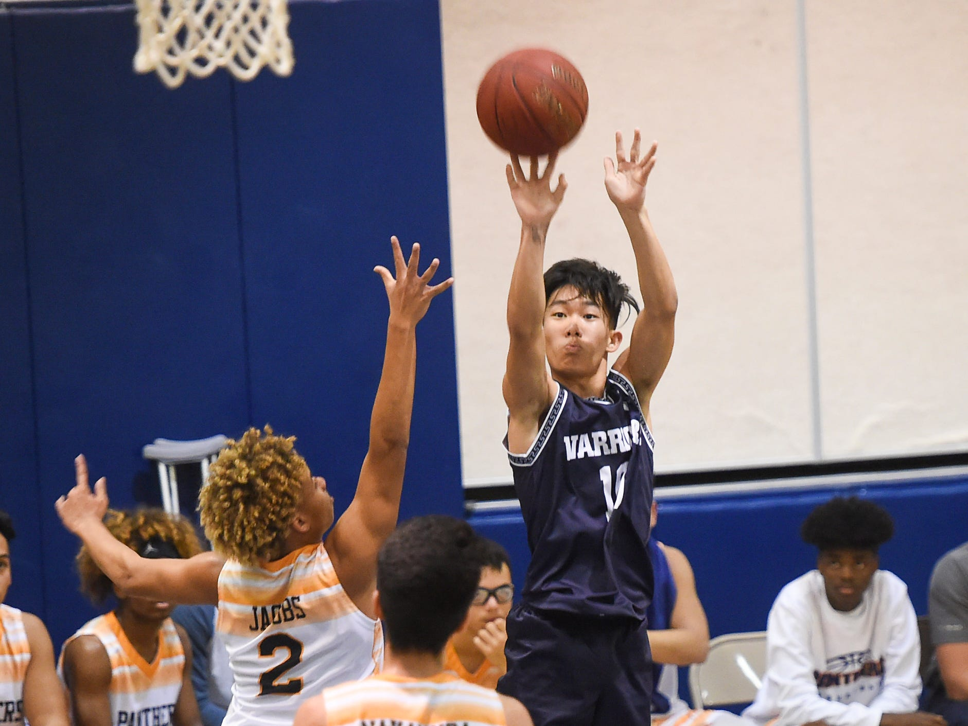 St. Paul's Hyato Tsuji pulls up for a jumper against the Guam High Panthers during their IIAAG Boys' Basketball game at the Guam High School Gym, Feb. 5, 2019.