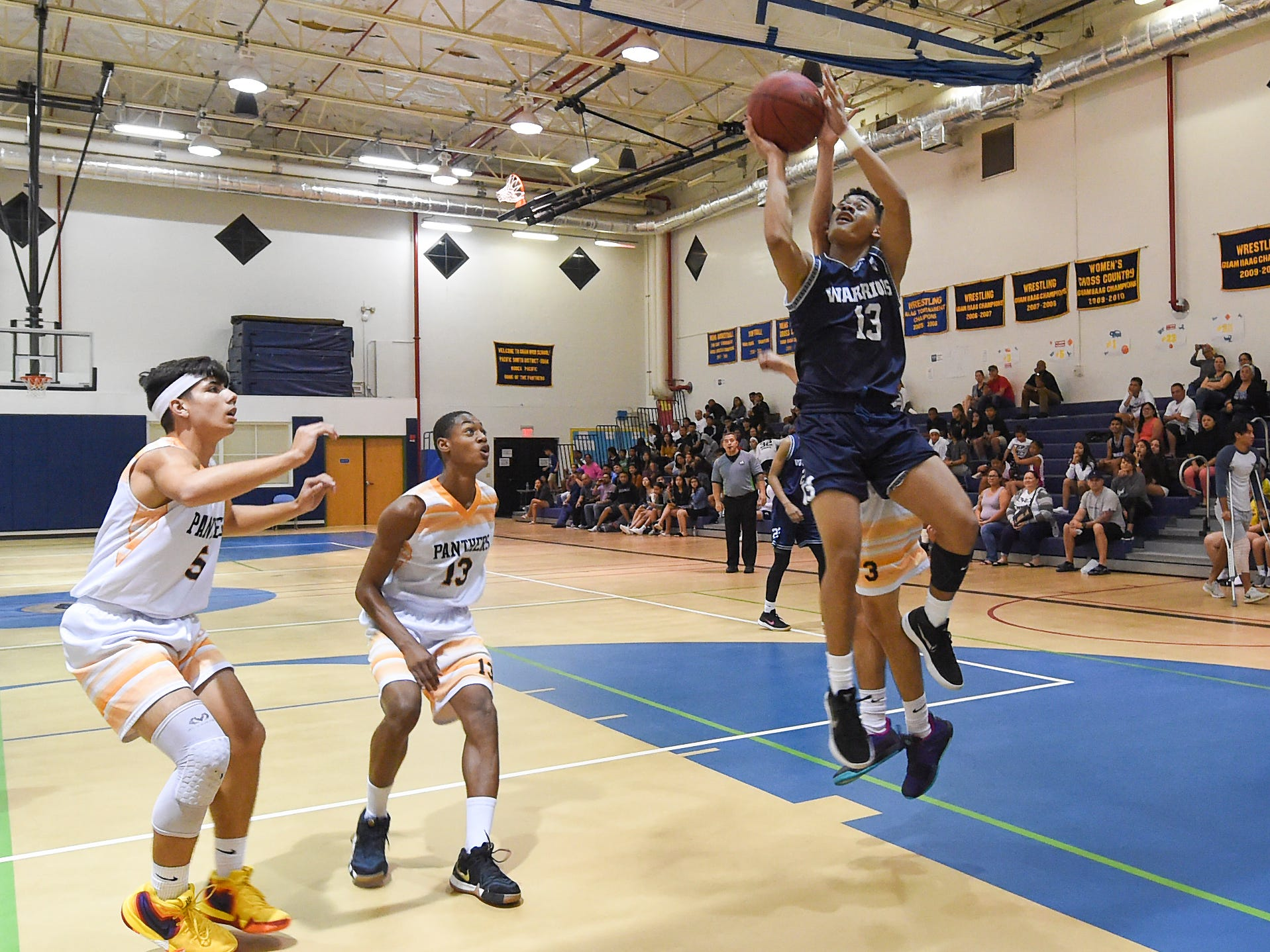 The Guam High Panthers faced the St. Paul Warriors for their IIAAG Boys' Basketball game at the Guam High School Gym, Feb. 5, 2019.