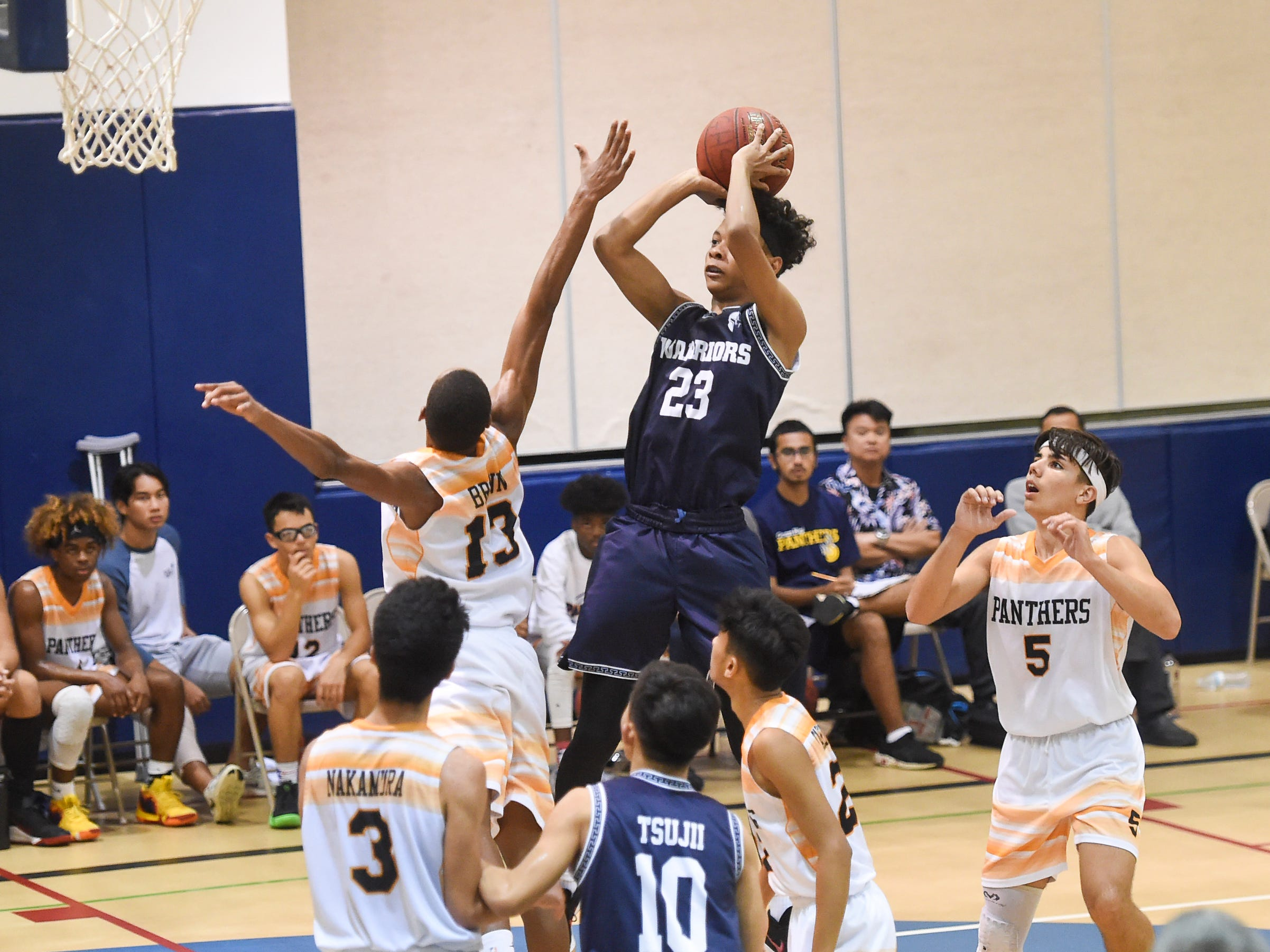 St. Paul's Reo Aiken (23) takes a jump shot against the Guam High Panthers during their IIAAG Boys' Basketball game at the Guam High School Gym, Feb. 5, 2019.