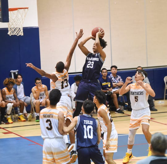 Saint Paul's Reo Aiken takes a jump shot against the Guam High Panthers during an IIAAG Boys Basketball game at the Guam High School Gym in this Feb. 5 file photo.