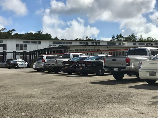 Guam Police Department officers parked outside Agueda I. Johnston Middle School in Ordot after a student reportedly said he had a bomb on Tuesday.