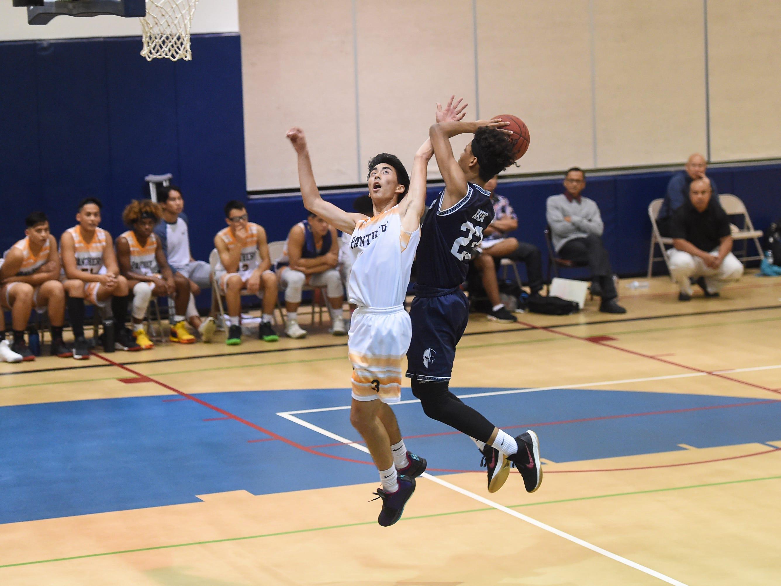 St. Paul's Reo Aiken (23) adjusts his shot on a fast break layup against a Guam High player during their IIAAG Boys' Basketball game at the Guam High School Gym, Feb. 5, 2019.
